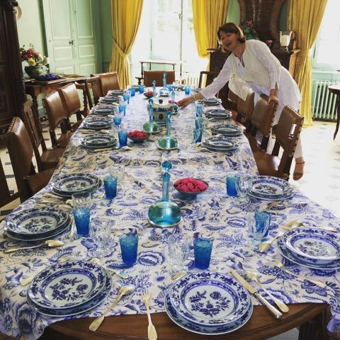 "Marie Saint Bris sets the table for ""le dîner bleu"" in the dining room of her family's Château Beauchêne in France's Loire River Valley  ."