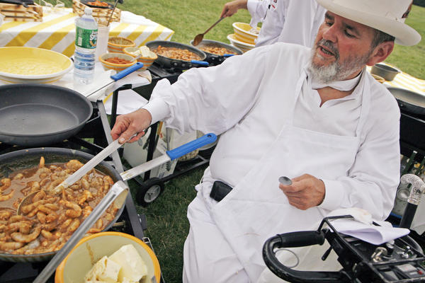 New Orleans Chef Paul Prudhomme prepares barbecue shrimp at the annual White House Congressional Picnic in 2007.    MARVIN JOSEPH / WASHINGTON POST/GETTY IMAGES