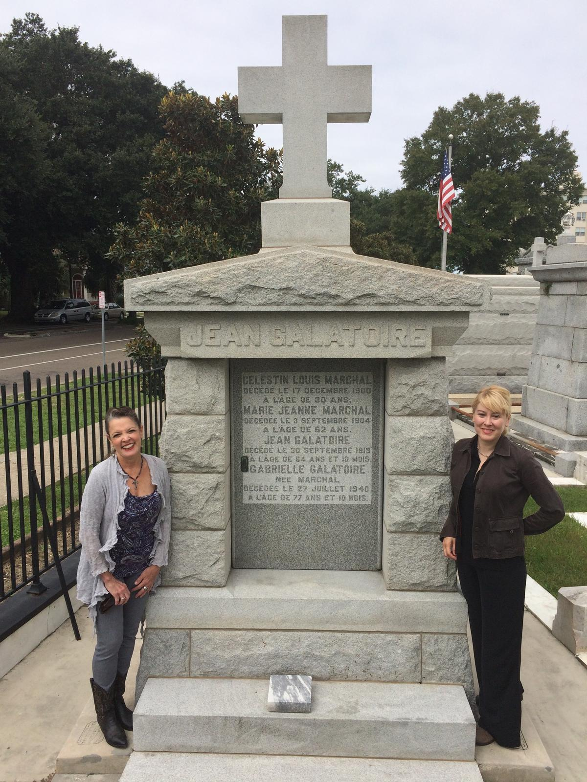 Poppy Tooker and Sally Asher at the grave of Jean Galatoire in St. Louis Cemetery No. 3.   CREDIT JOE SHRINER