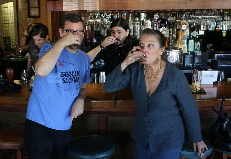 Chris Jay, bartender Aulden Morgan and Poppy Tooker sample the Carolina Reaper-infused vodka at Zocolo Neighborhood Eatery in Shreveport.    JOE SHRINER