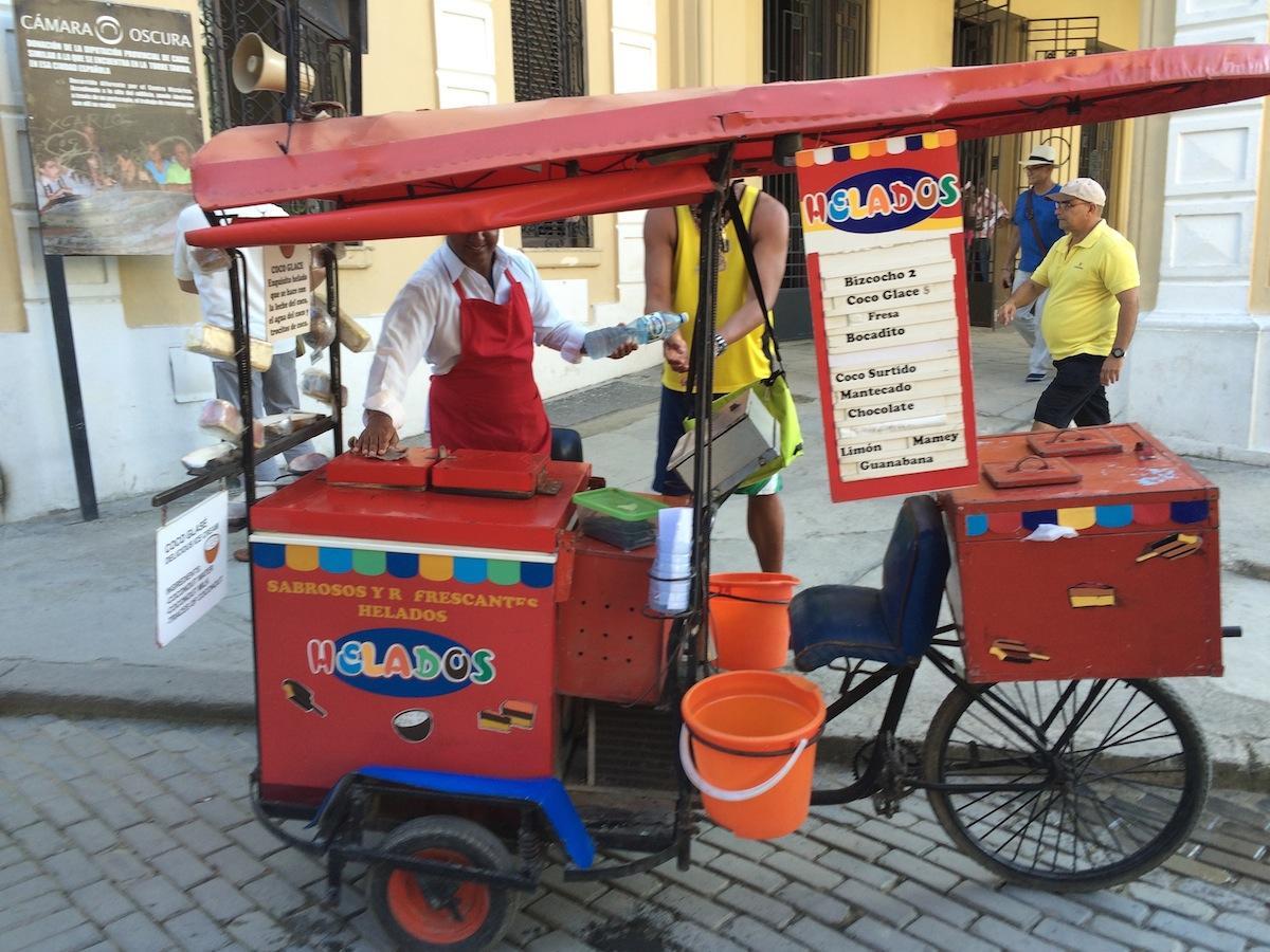 A vendor on the streets of Havana.  POPPY TOOKER