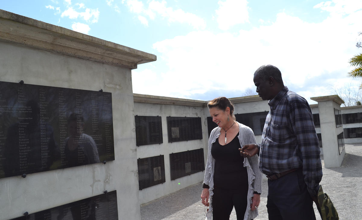 Host Poppy Tooker and Dr. Ibrahima Seck at Allées Gwendolyn Midlo Hall — a memorial dedicated to all the slaves who lived in Louisiana. Names and quotes are engraved on 216 granites slabs mounted on 18 walls.   CREDIT SARAH HOLTZ