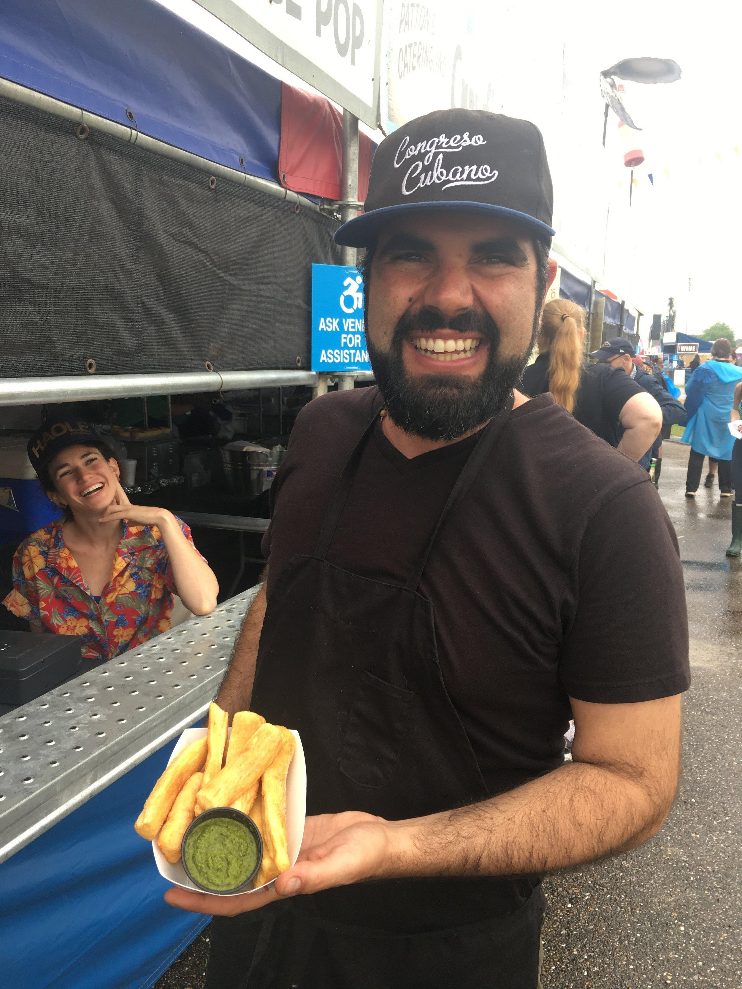 Orlando Vega At Congreso Cubano booth w/yucca fries & chimichurri.  Credit: Poppy Tooker, Louisiana Eats