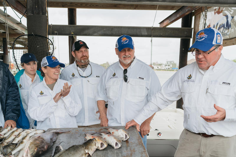 Poppy Tooker, chefs from the Dickie Brennan Restaurant Group and Dickie Brennan show off their catch of the day.    PAUL BROUSSARD