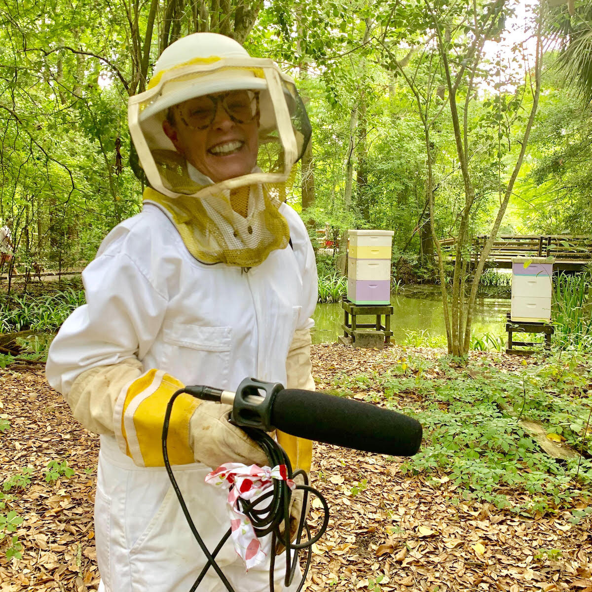 Host Poppy Tooker suits up to get a firsthand look at the hives of honey bees at Audubon Zoo.  Credit:  Annie Kinler Matherne