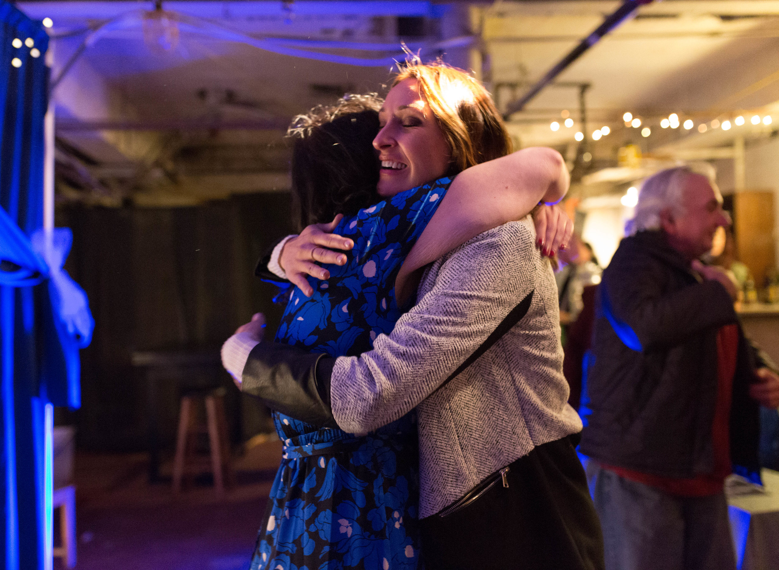 "Amy Brooks (left) and Kristin Schroeder (right) embrace after the end of the Boston Academy of Burlesque Education student showcase on Nov. 6, 2016 in Cambridge, Mass. Schroeder, Brook's best friend, flew in from Minneapolis to see her perform. ""She was in really abusive, manipulative relationships...and she doesn't put up with that crap anymore, and she's starting to date guys that are worthy of her,"" Schroeder said."
