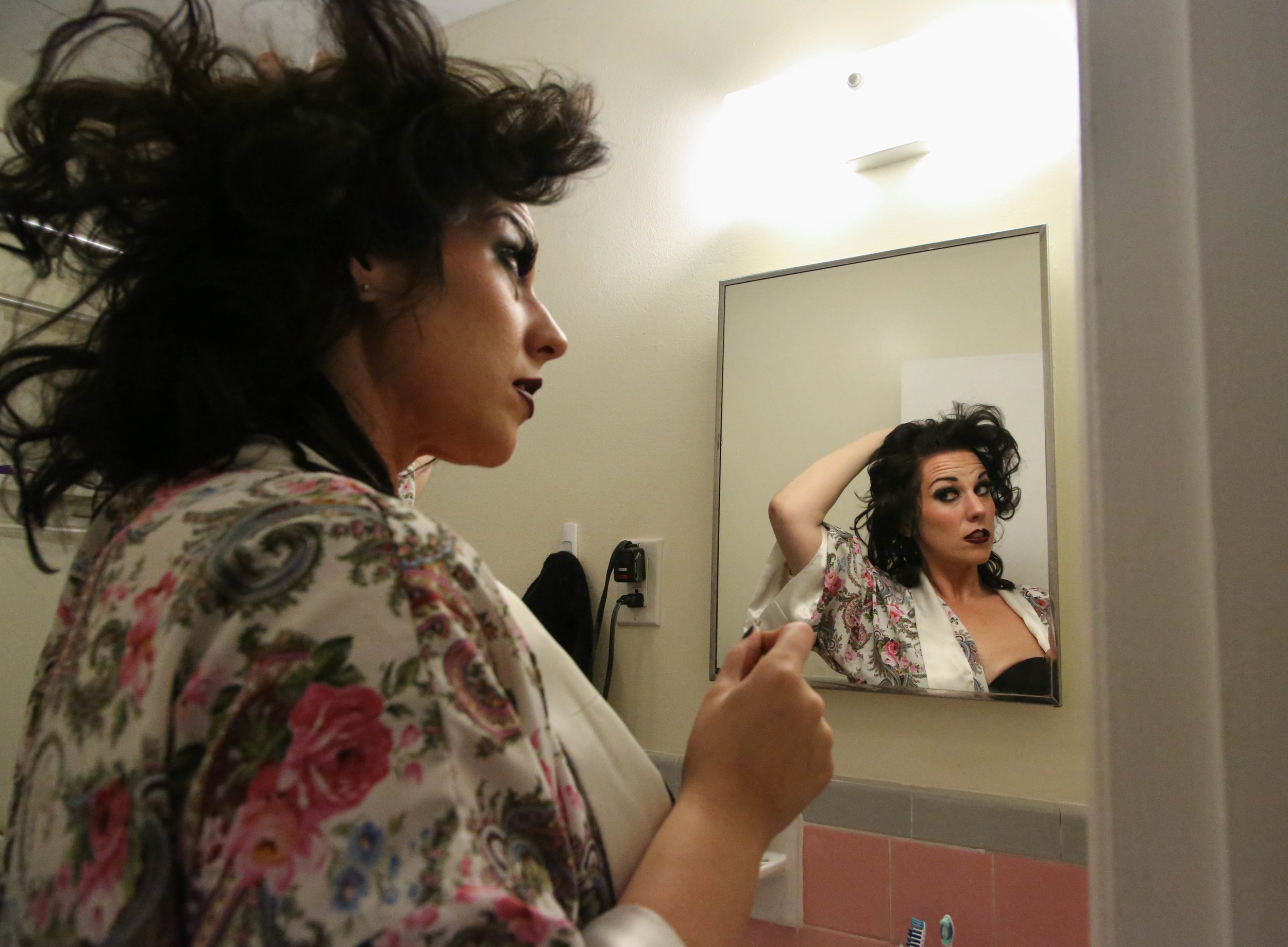 "Amy Brooks, 33, fixes her hair before the first dress rehearsal of the ""Wrathskellar Tales,"" a production of the Burlesque Troupe, ""The Boston BeauTease,"" in Quincy, Mass. on Oct. 19, 2016. Brooks began taking Burlesque classes last summer. She grew up in a conservative and religious home, and attended Olivet Nazarene University in Ill. ""[I] would have prayed for her,"" Brooks said, describing how she would have felt in college if she knew how she acts now."