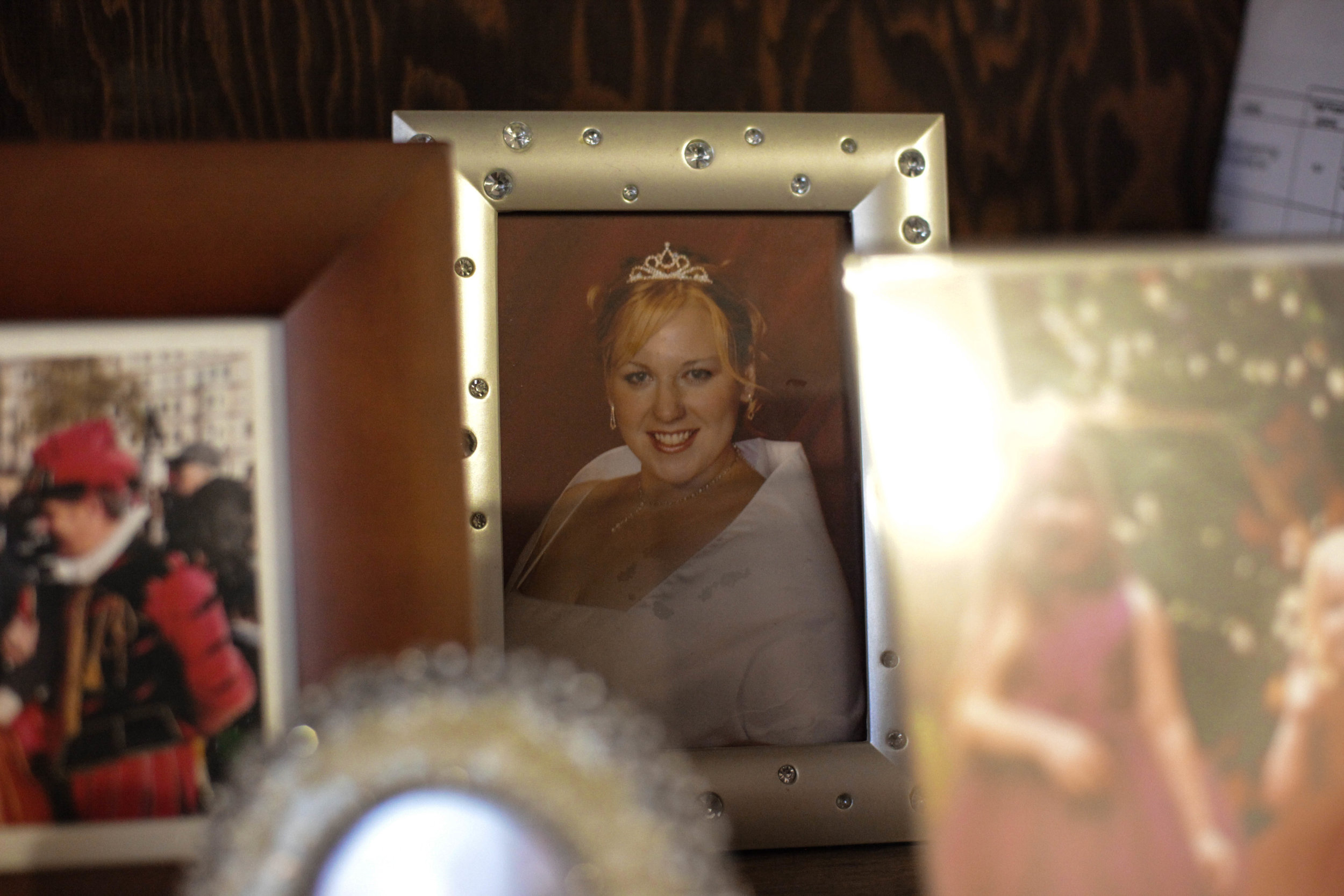 A photo of Brooks in college sits on her mantle in her home on Oct. 19, 2016 in Quincy, Mass.