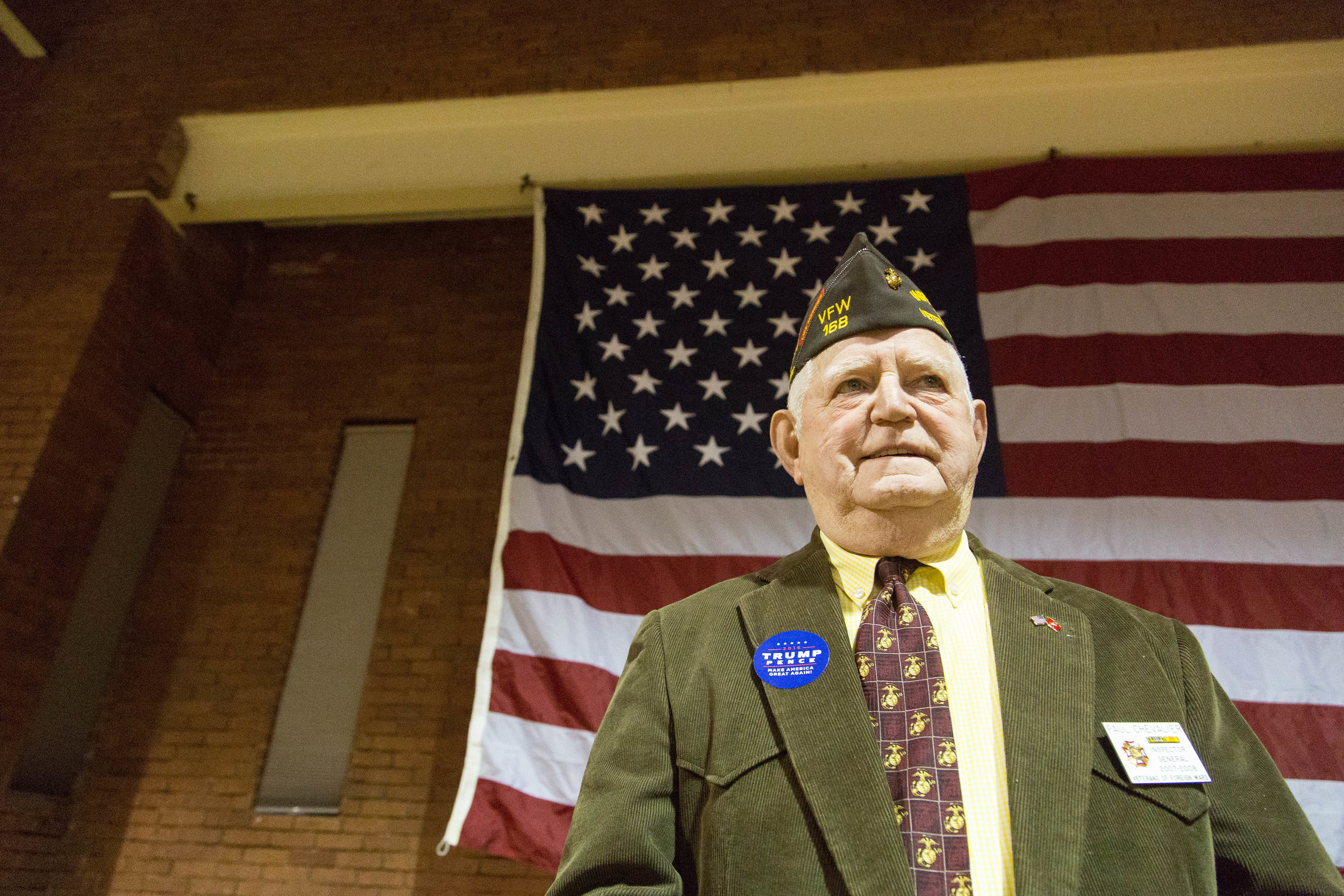 "Paul Chevalier, 79, of Hudson, N.H. poses for a portrait before the start of the ""Donald J. Trump for President Rally."" Chevalier served in the Marine Corps for 31 years, and in the Vietnam War three times."