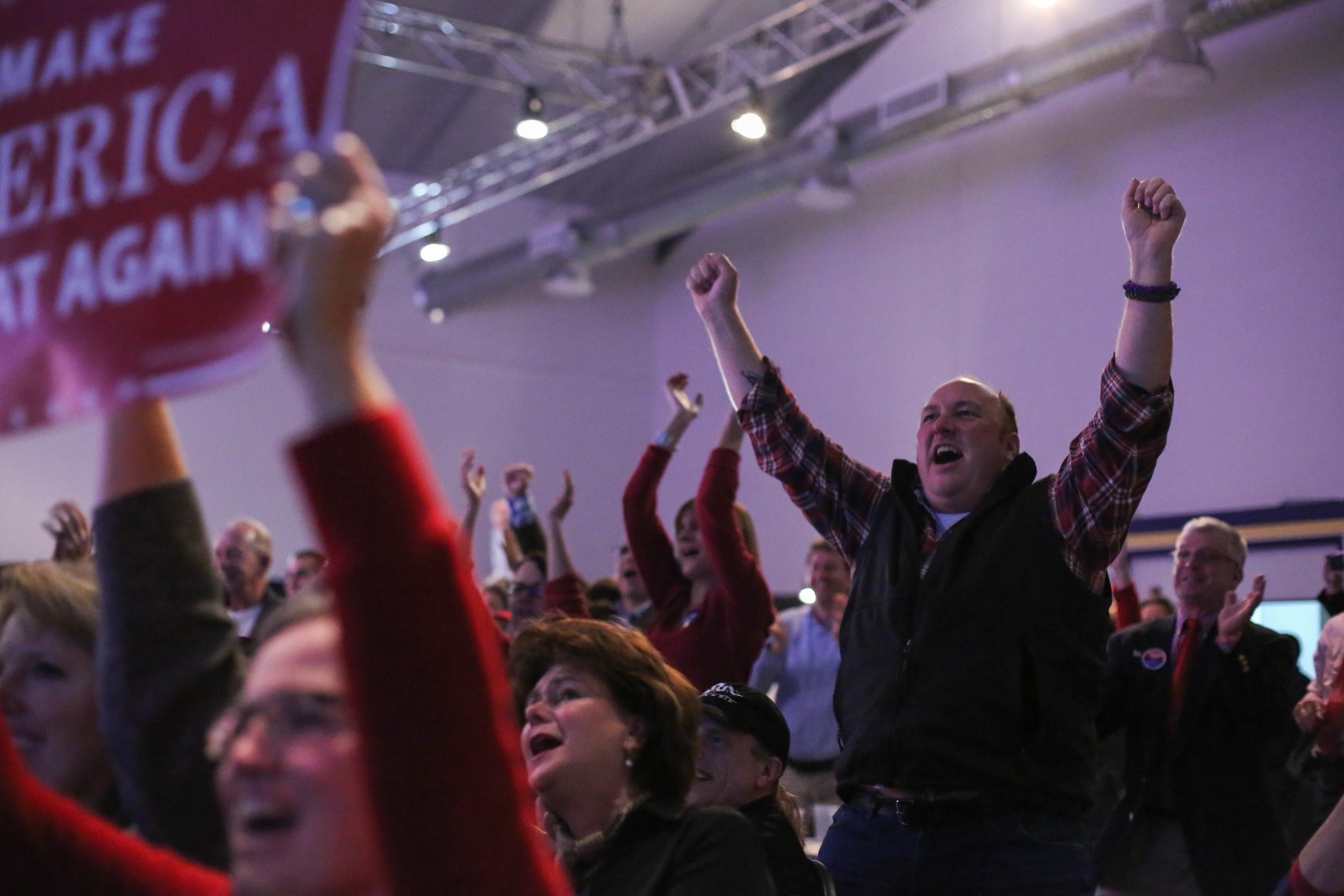Supporters cheer as Trump wins a state during  the Massachusetts Trump-Pence Campaign victory party at the F1 Boston race track.