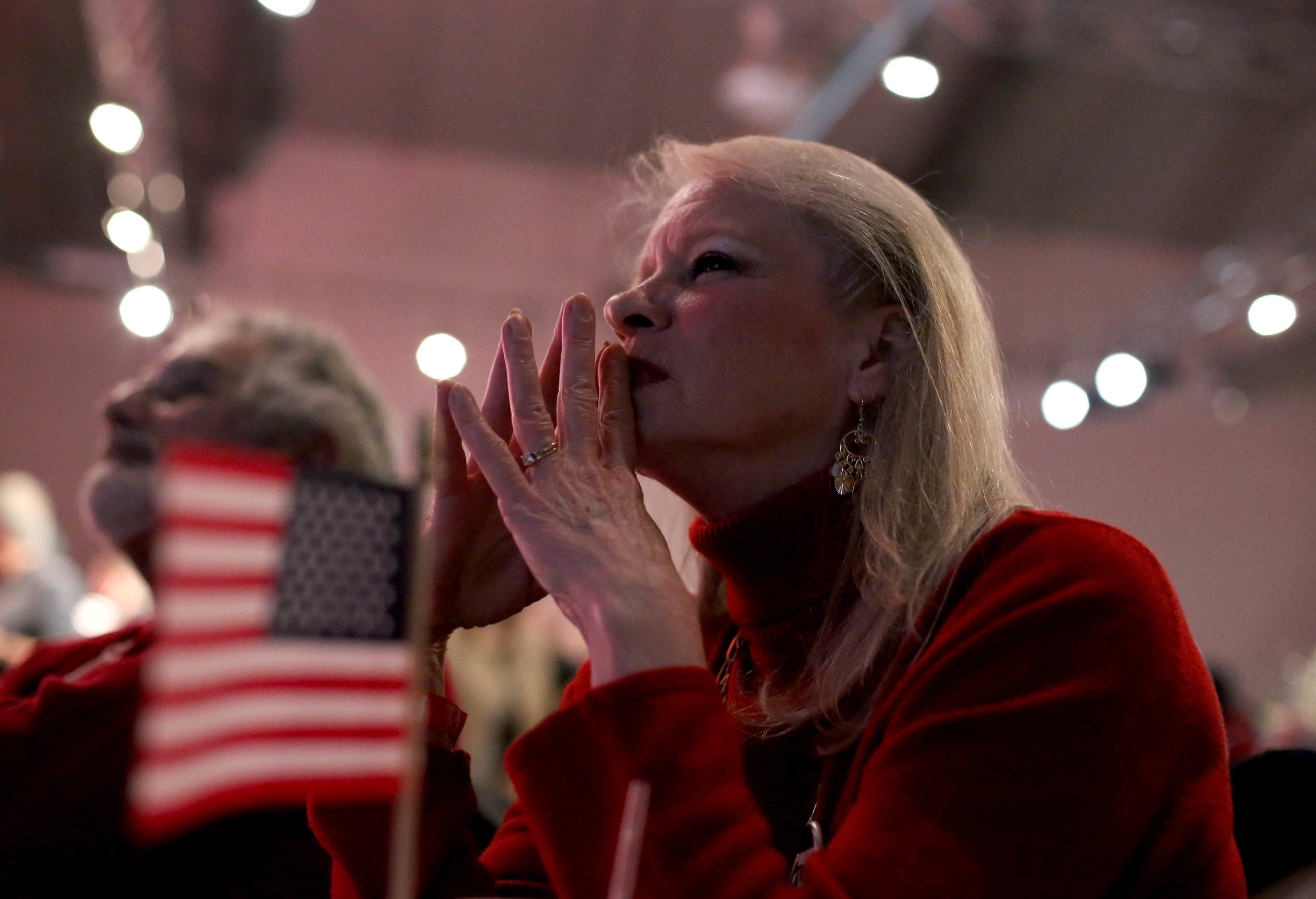 Diane LaRaiea, 64, reacts to Fox News election results during the Massachusetts Trump-Pence Campaign victory party at the F1 Boston race track in Braintree, Mass. Supporters gathered to watch live polling results and cheer for Donald J. Trump as he was elected the next president of the United States on Nov. 8, 2016.