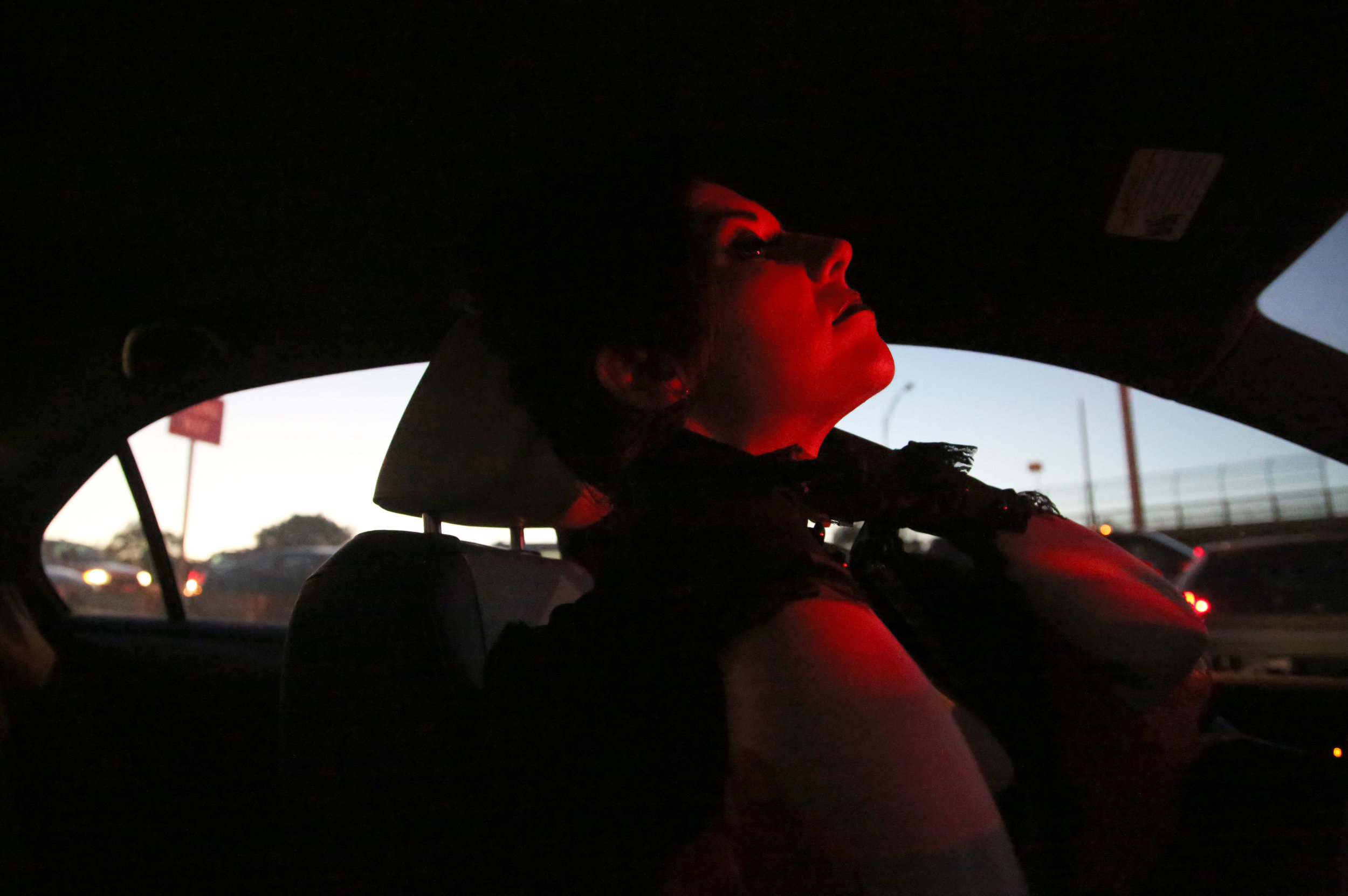 "Amy Brooks adjusts her choker while waiting in traffic on her way to the first dress rehearsal of the ""Wrathskellar Tales"" on Oct. 19, 2016 in Cambridge, Mass.   ""The way that I was brought up was to cover. That more is better. That you don't tempt men with what you're wearing…but this is what I need to be doing right now,"" she said."