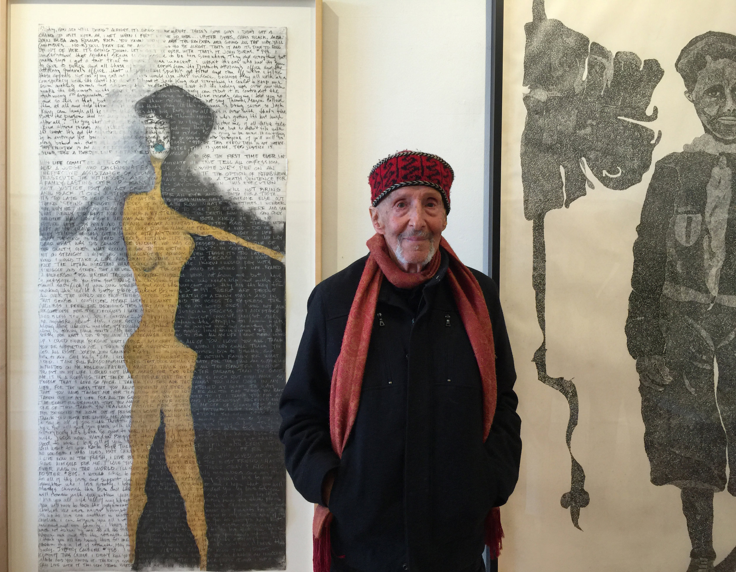 """Kamler with (left) """"Last Statement,"""" 1998, graphite, oil stick on paper, 61 x 31 inches; right: """"Boy Warrior,"""" 1975, graphite on paper, 75 x 36.5 inches"""