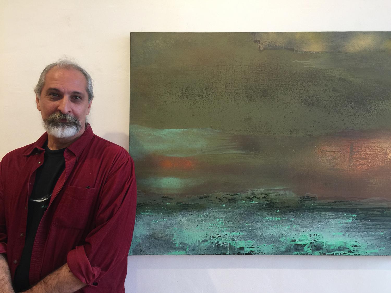 Yari Ostovany  with his painting  Oracle II