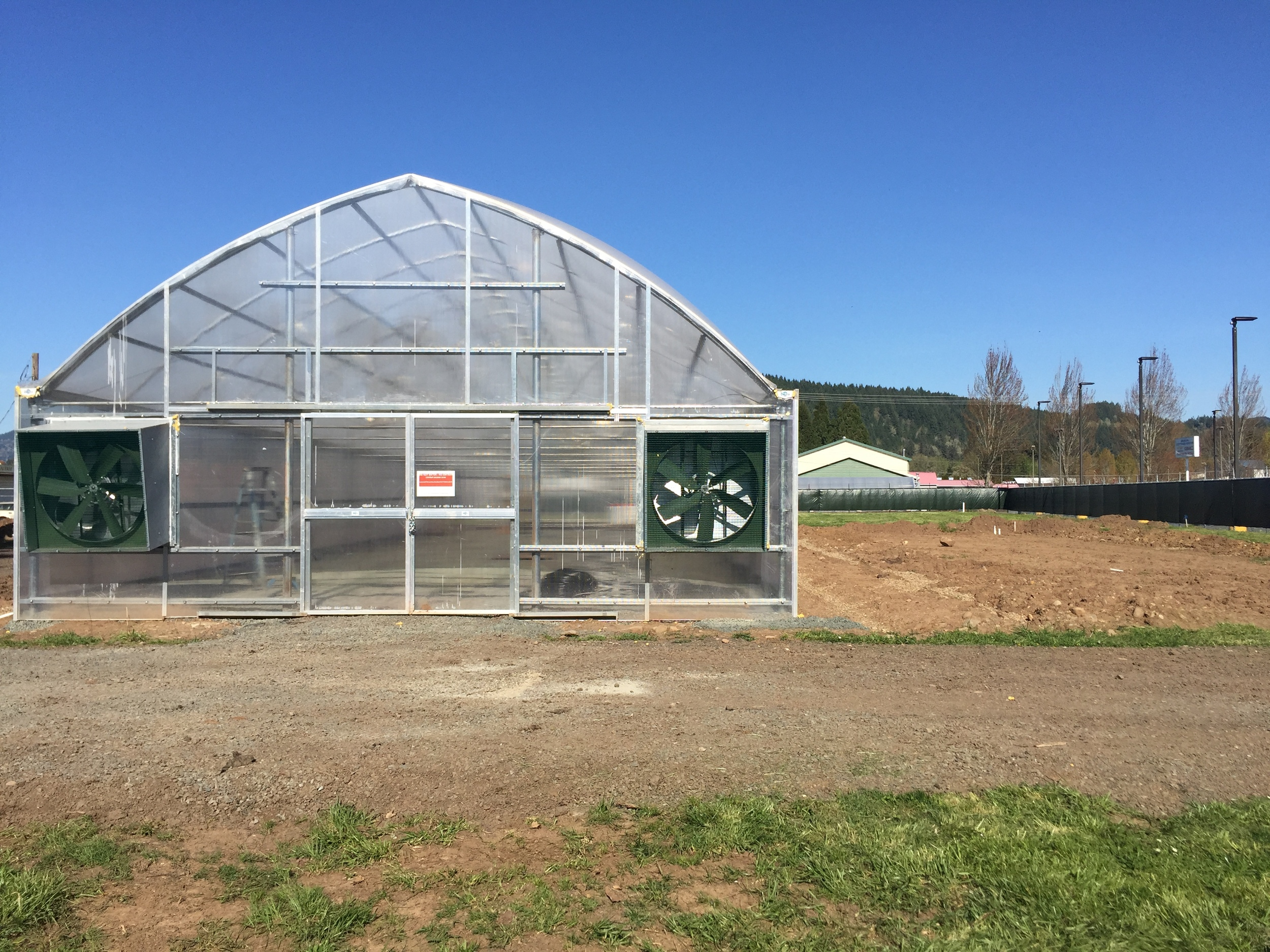 For those of you who might be curious, the greenhouse is a Conley 3600 - heated by gas and cooled by a high-pressure fog system.