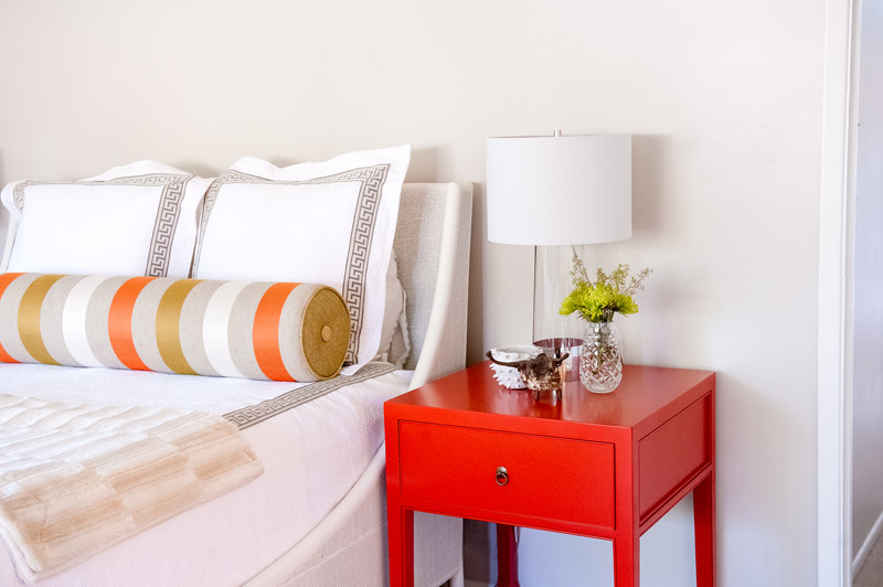 master-bath-red-nightstand-bed-pillows.jpg