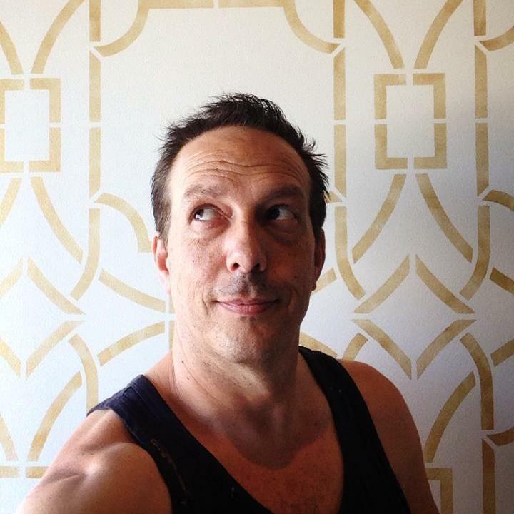Headshot, Christopher Macon with a Custom Wall Finish