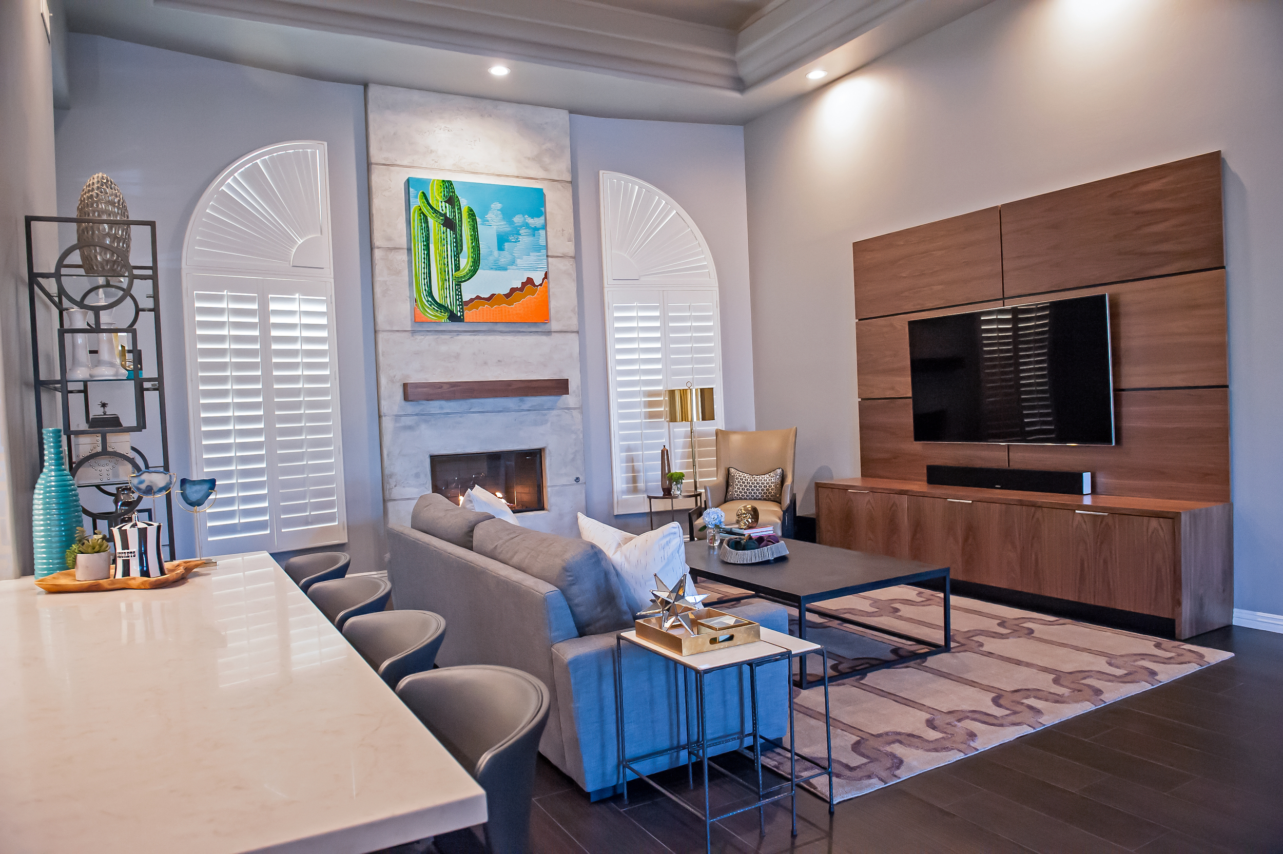 After, Bold Living Room with Custom Fireplace and Entertainment Center