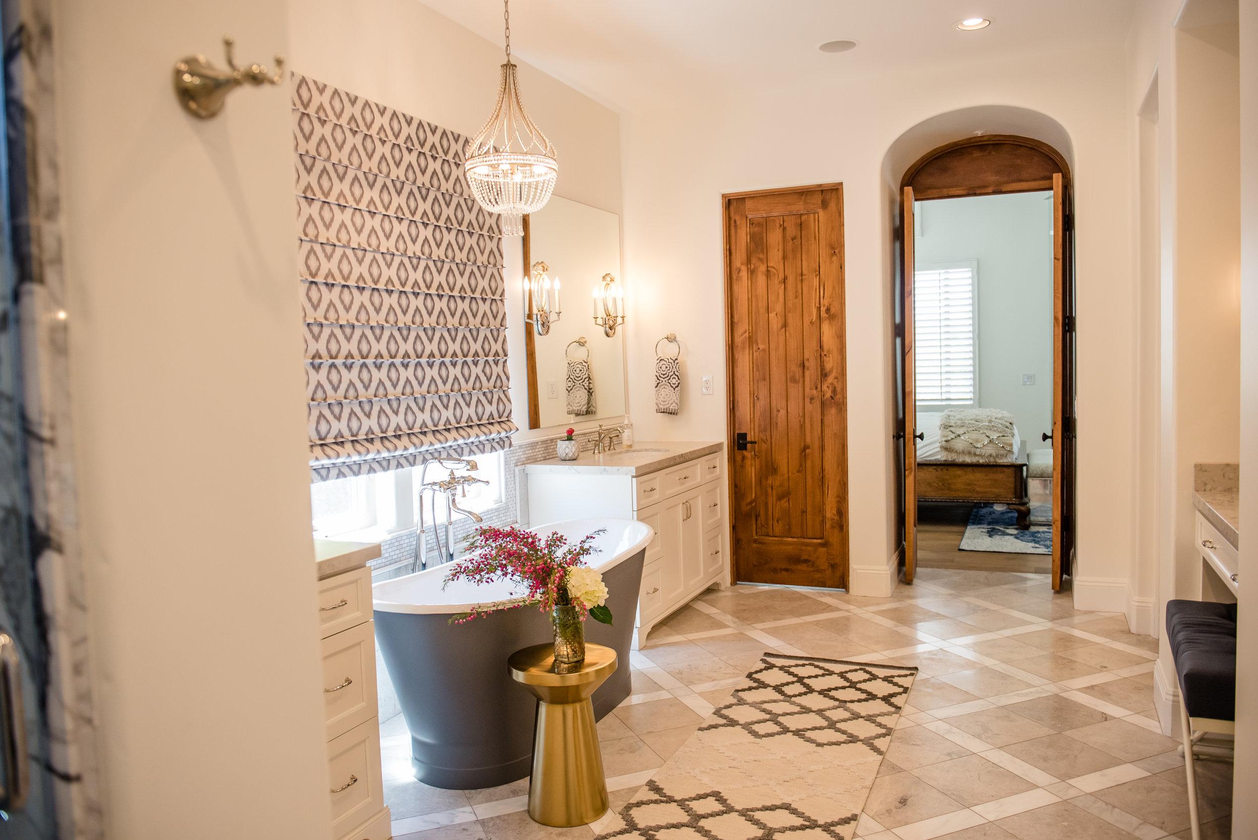 37+masterbath+romanshade+marble+inlayfloor+graybathtub+vanity+chandelier+runner.jpg