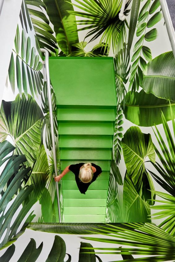 """Here in the very warm summer desert, we don't get the pleasure of feeling a """"tropical breeze"""". How we can incorporate the tropical feel into a desert home is spice up the walls or the decor. A summer trend for 2018 , for interiors has revolved around the tropical leaves and their nature, bright colors. Wallpaper is always a great way to incorporate that vibe of being in a tropical oasis. When trying to make a room feel like the trends feel but not wanting to overload it, you can add decor in different parts of the room as well. When all is done, grab a drink , a good book and press play to your tropical Pandora station!"""
