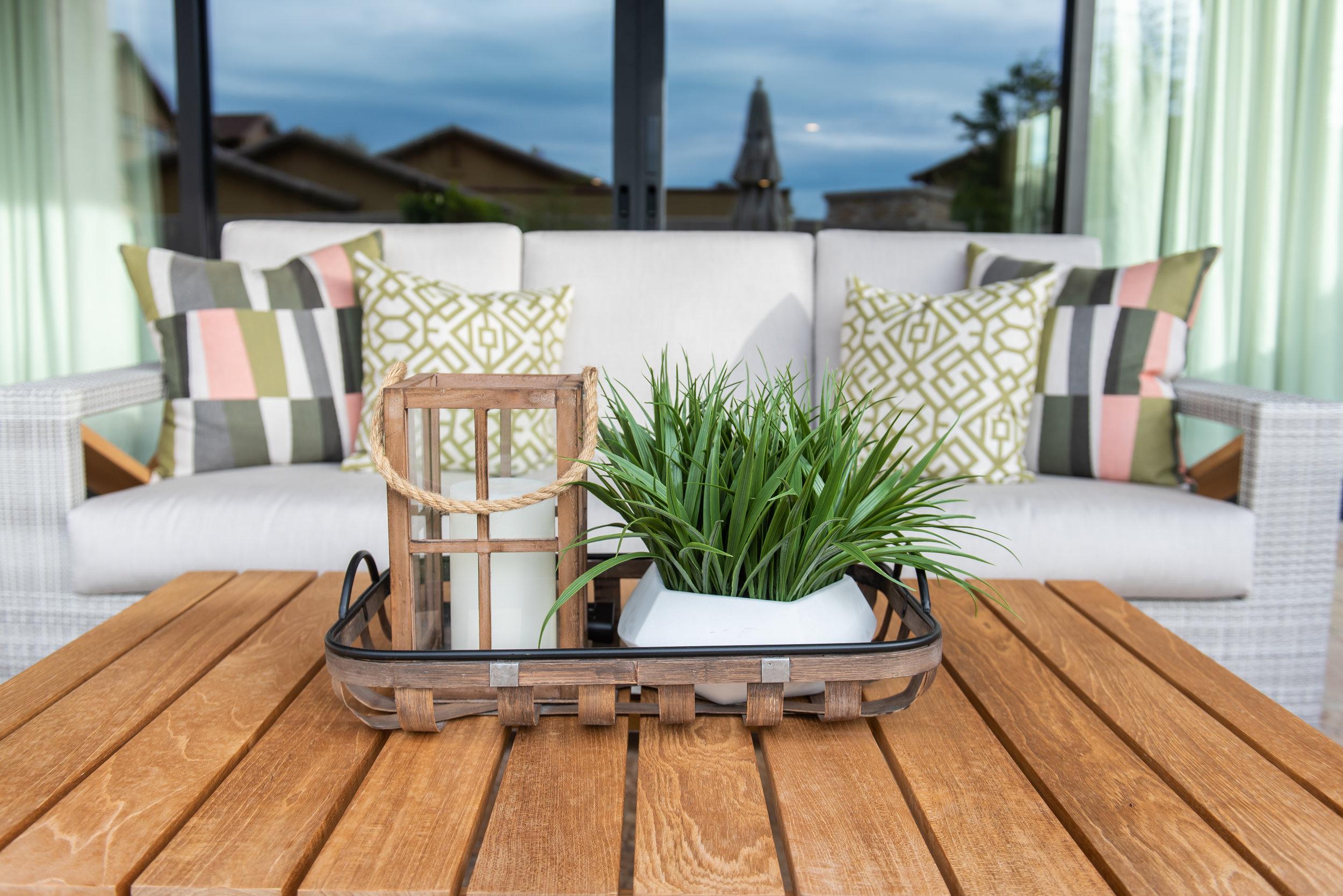 Backyard +patio +outdoor +furniture +pillows +coffeetable +plant.jpg