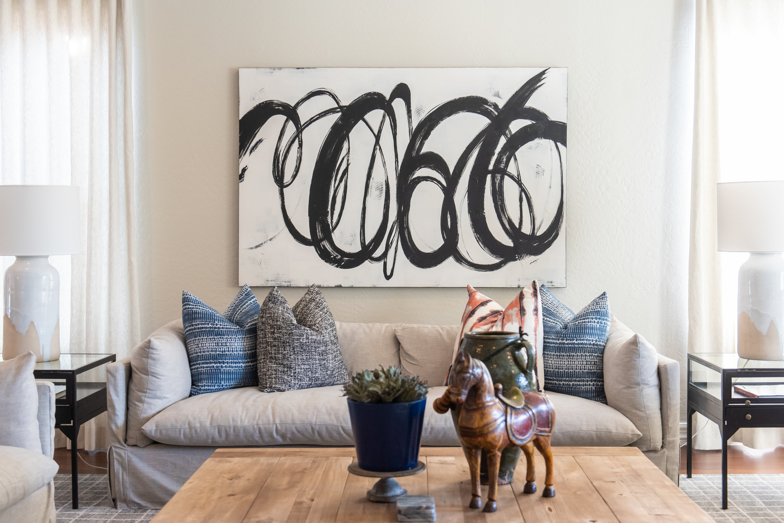 Family Room +couch +abstract-art +wood +coffee-table +accessories .jpg