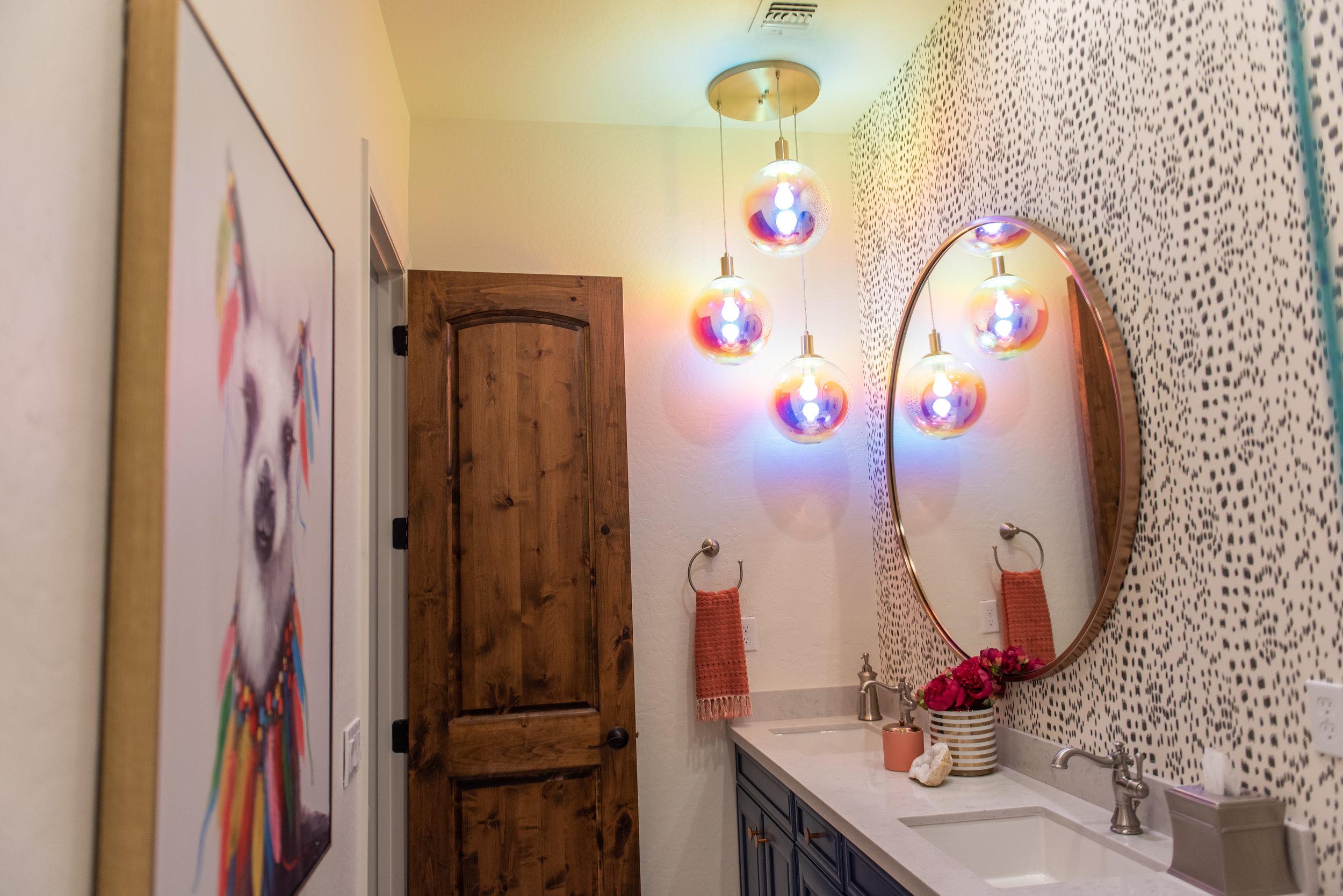 girls bathroom +round +mirror +wallpaper +lighting +artwork.jpg