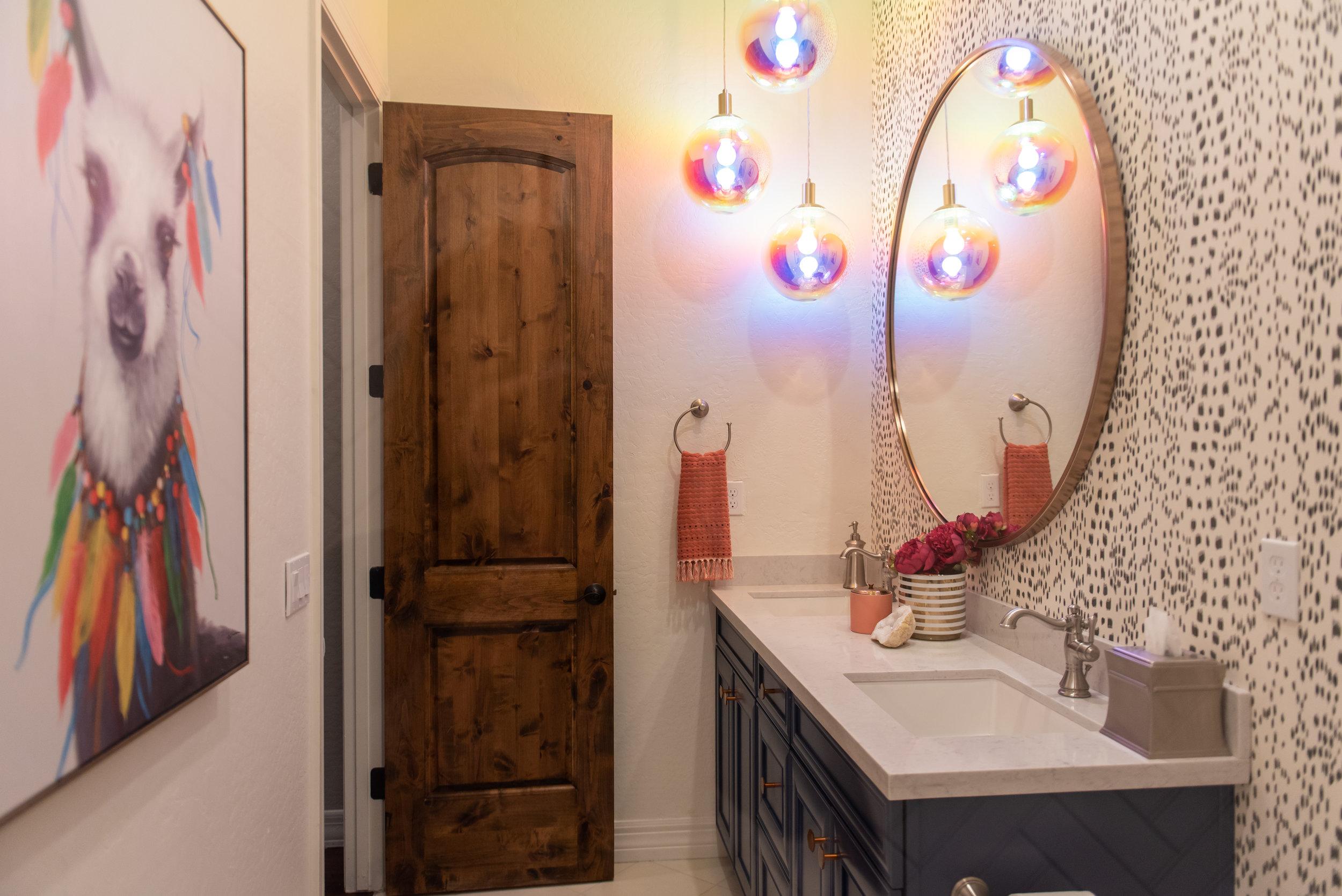 girls bathroom +wallpaper +round +mirror +artwork +lighting.jpg