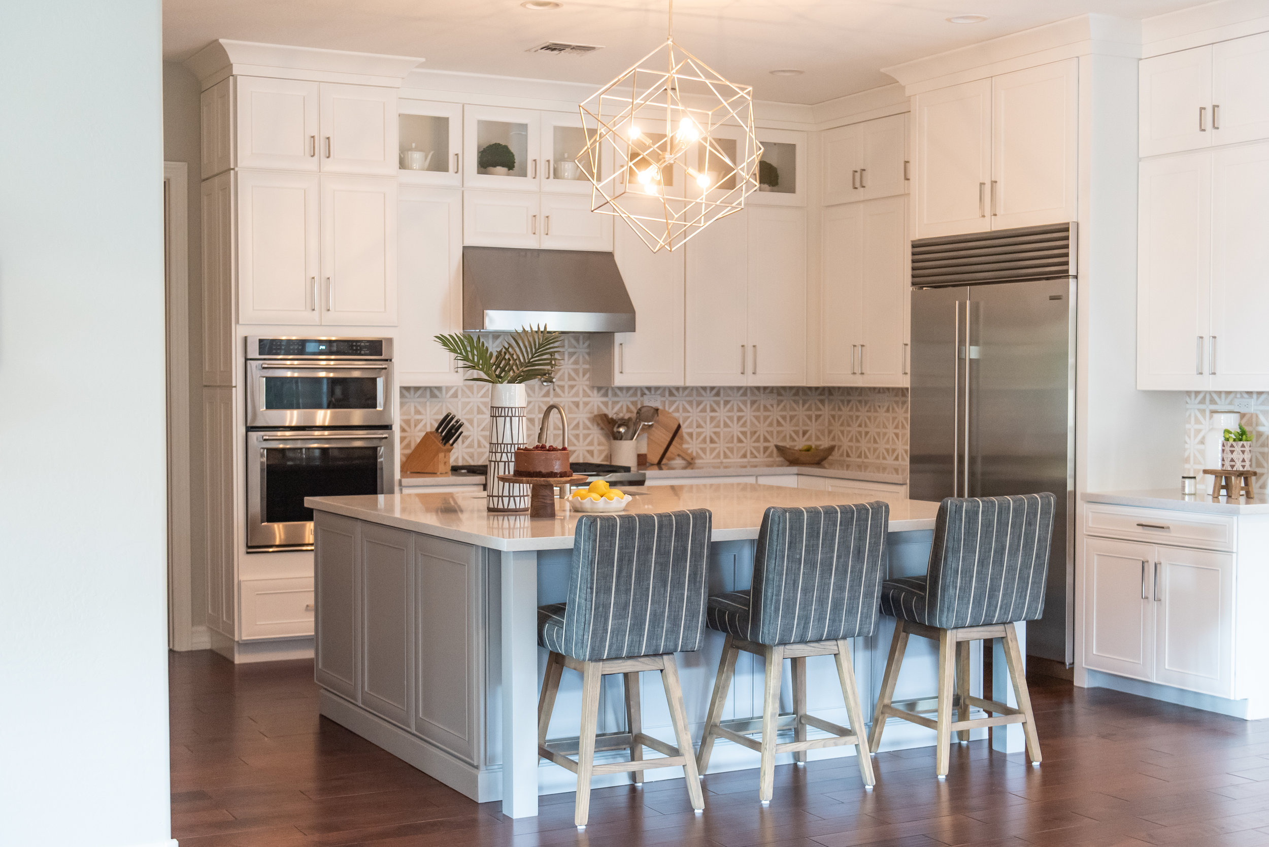 Kitchen +geometric +lighting +backsplash +hood +barstools +silestone +white-cabinets.jpg