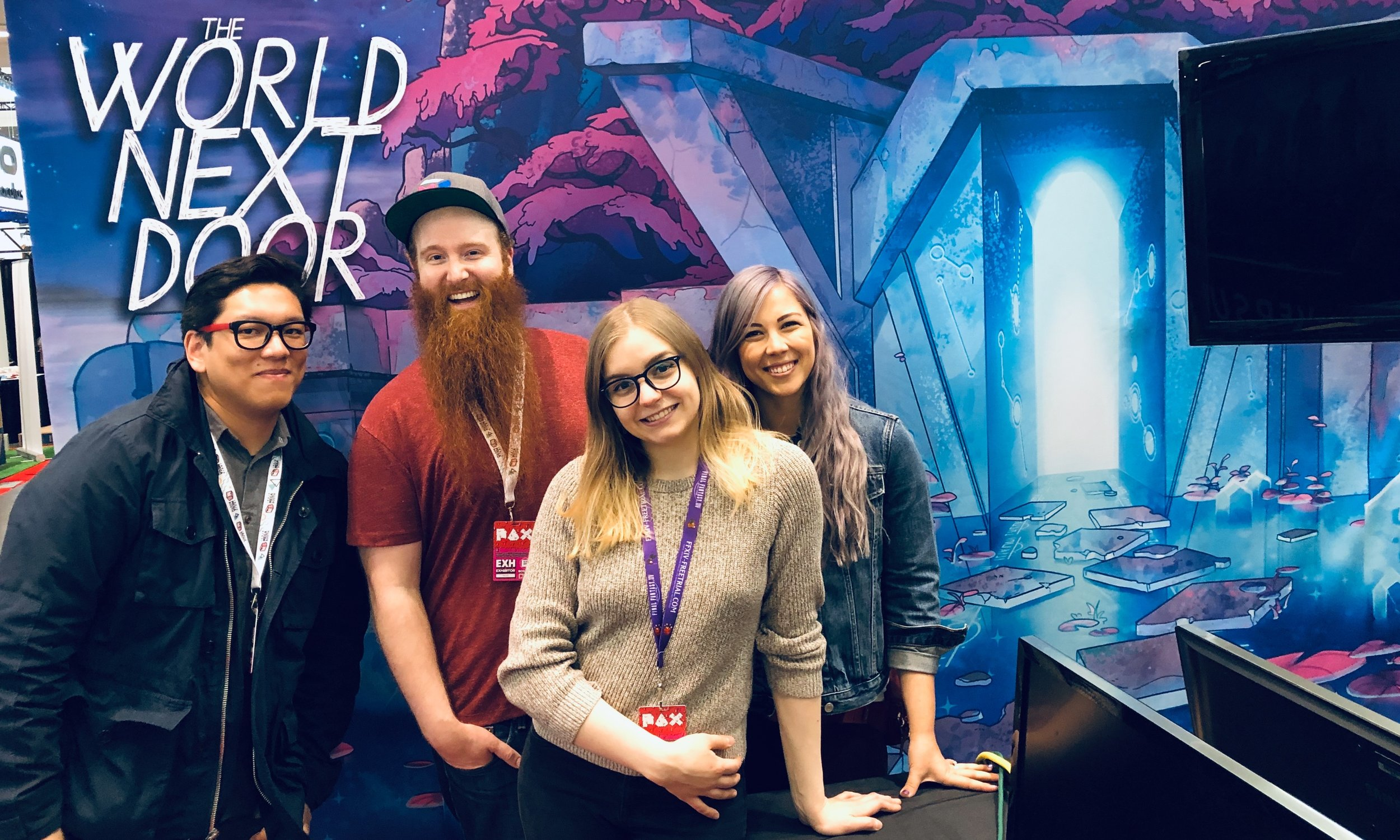 """Cyrus, Will, Marlowe, and Jenny, ready to greet PAX East visitors with a cheery, """"Salutar!"""""""