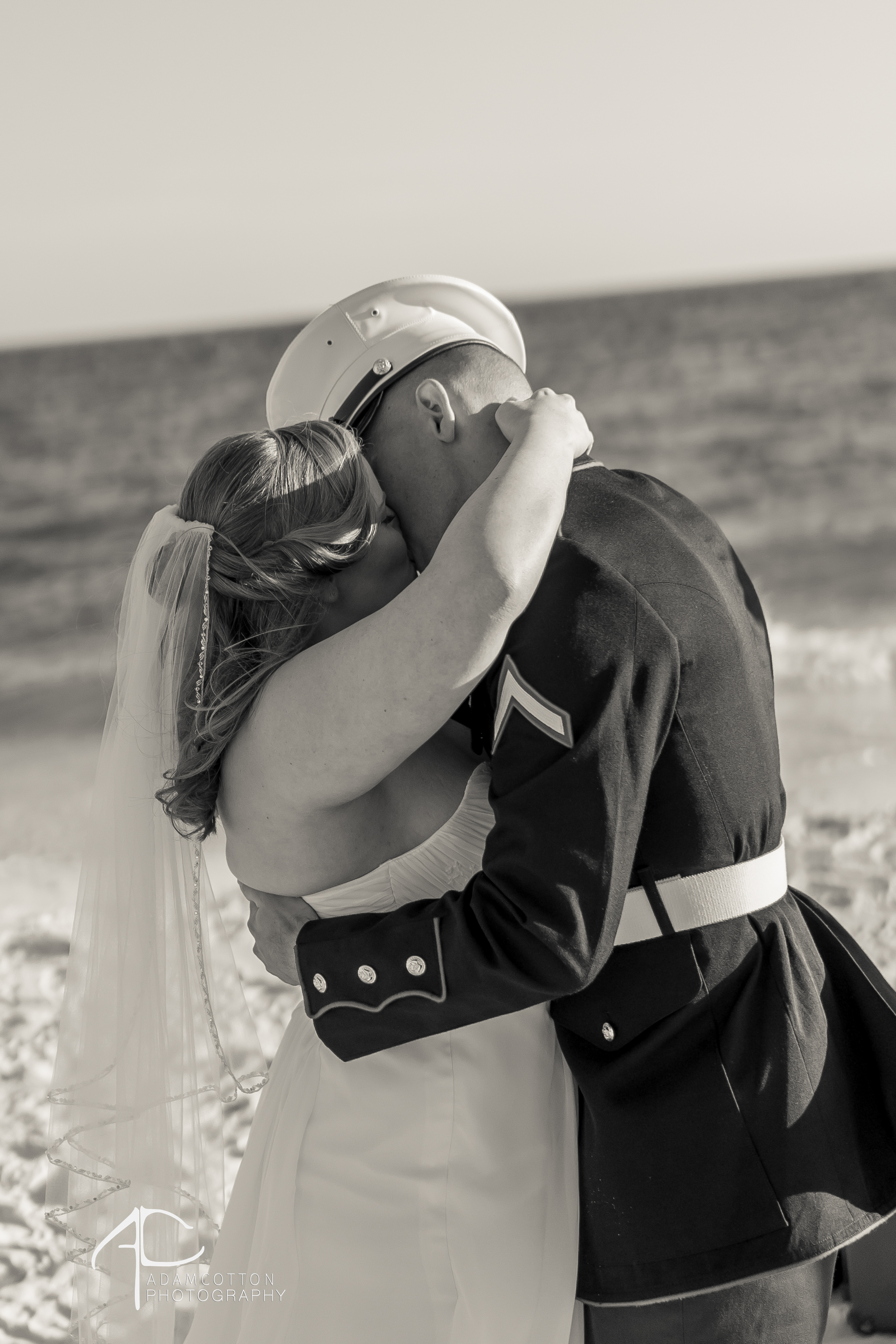 black and white image of bride and groom kissing pensacola beach wedding