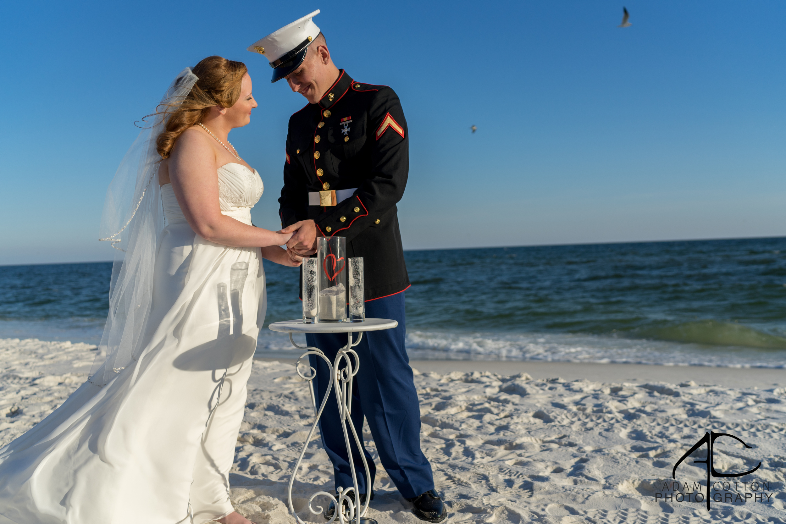image of bride and groom pouring sand into glass pensacola wedding