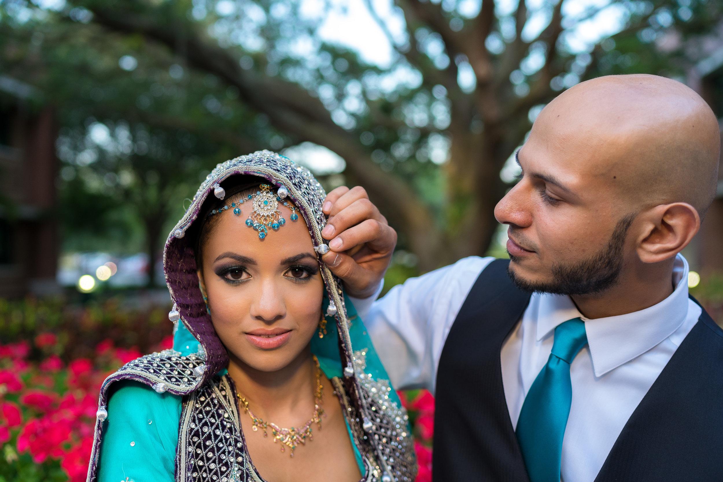 Bride-groom-portrait-candid-flowers.jpg