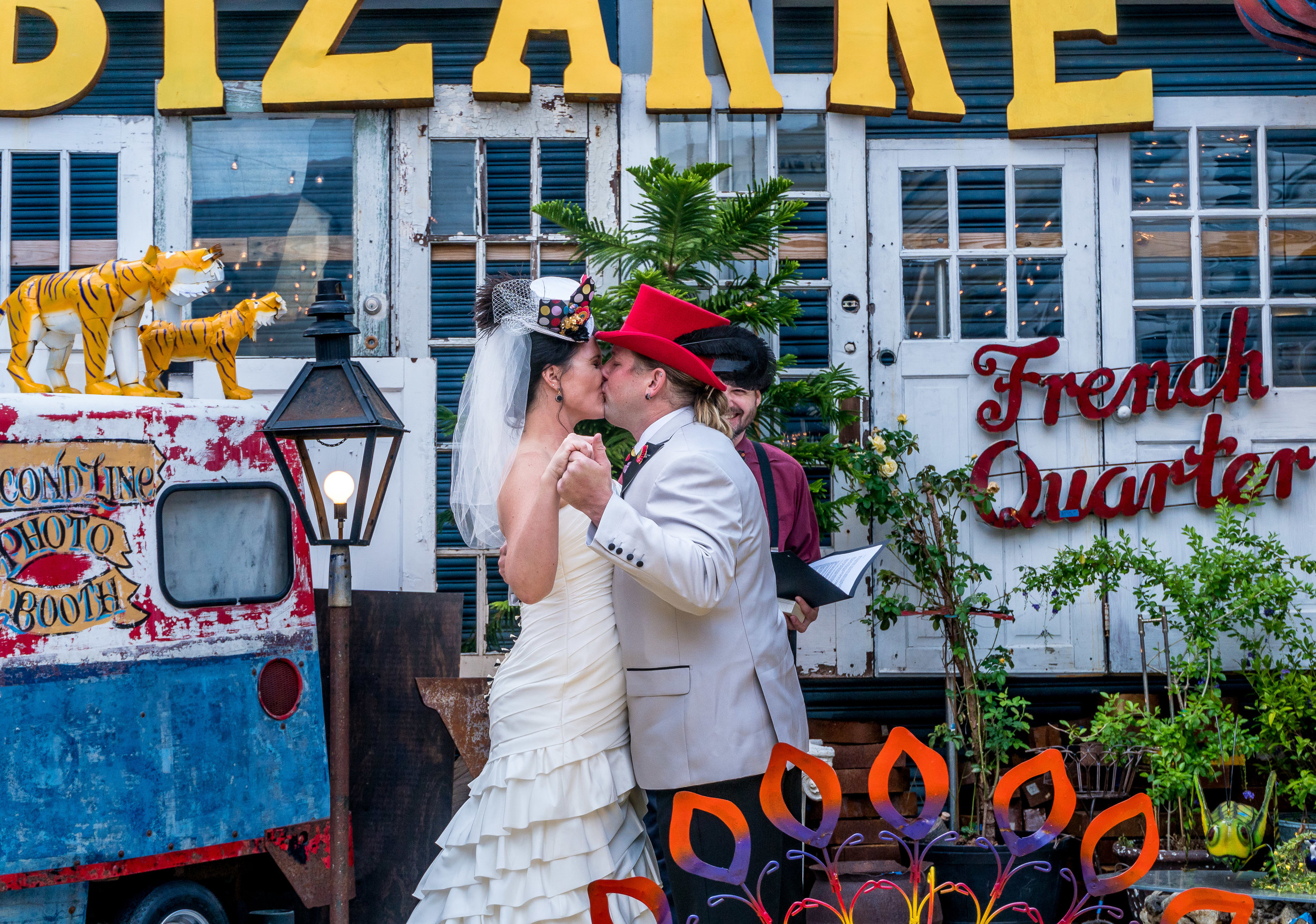adam cotton photography image of bride and groom first kiss wedding ceremony with dress and tuxedo in french quarter