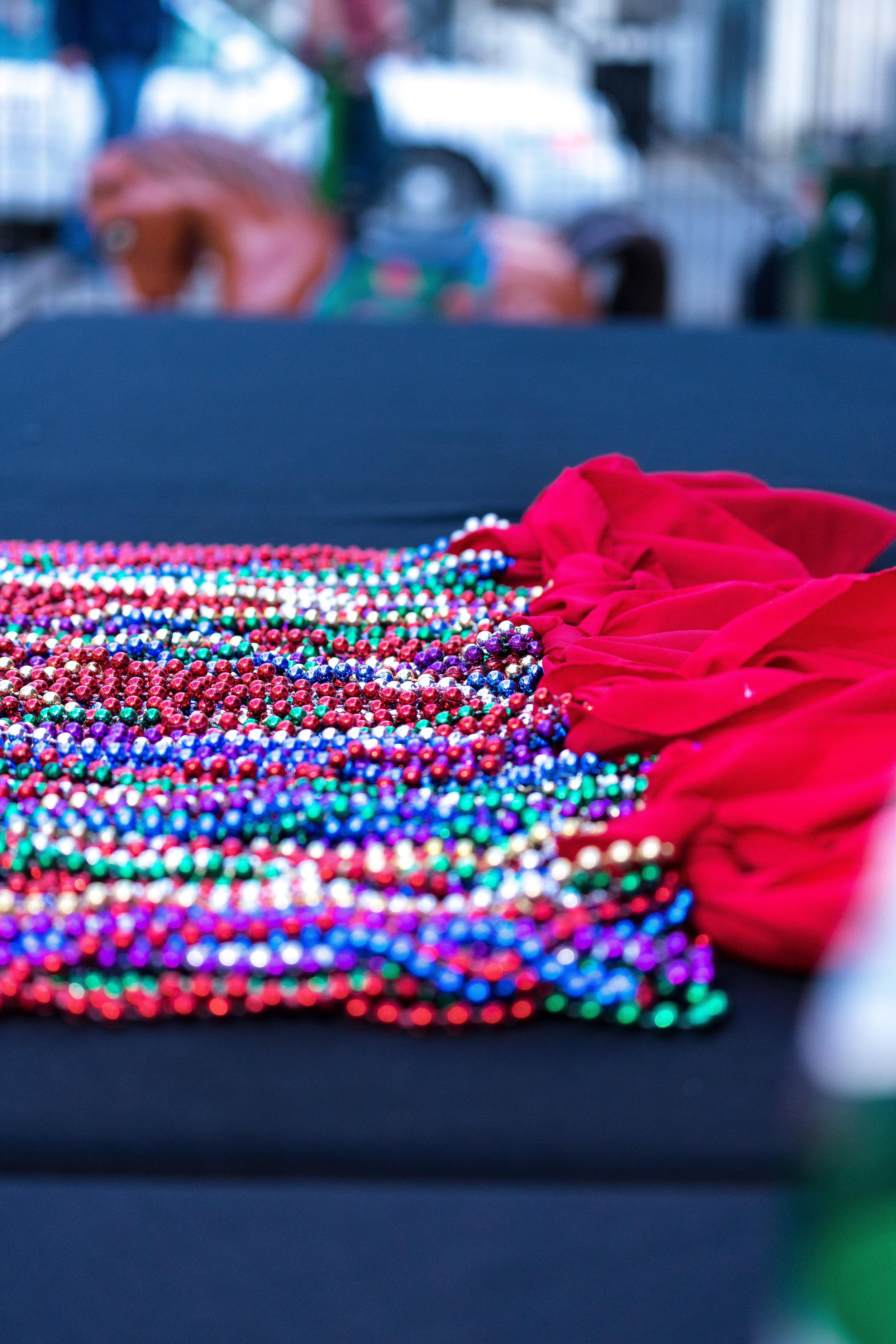 detail wedding image of mardi gras beads