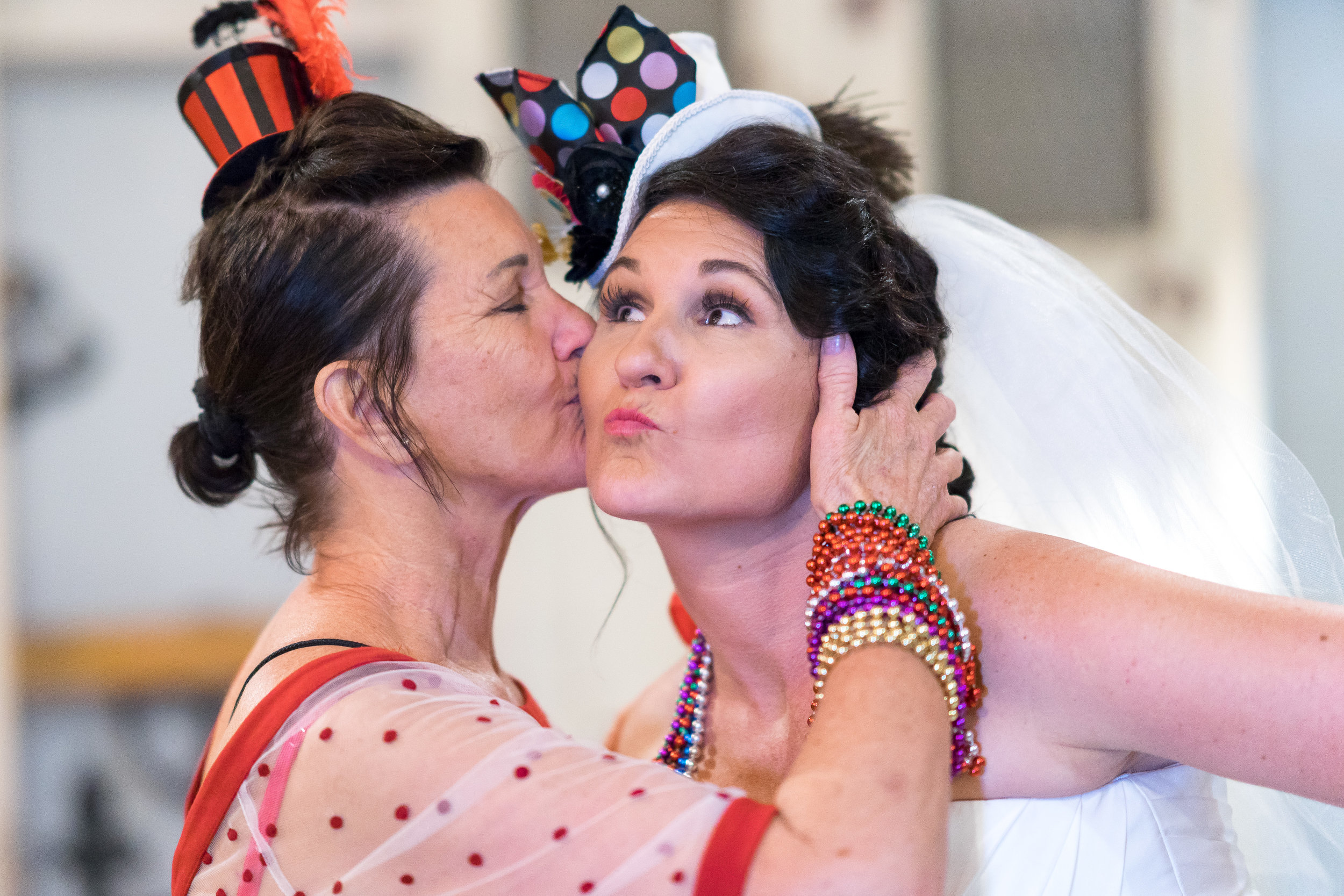 candid image of bride and mother at wedding by pensacola photographer adam cotton
