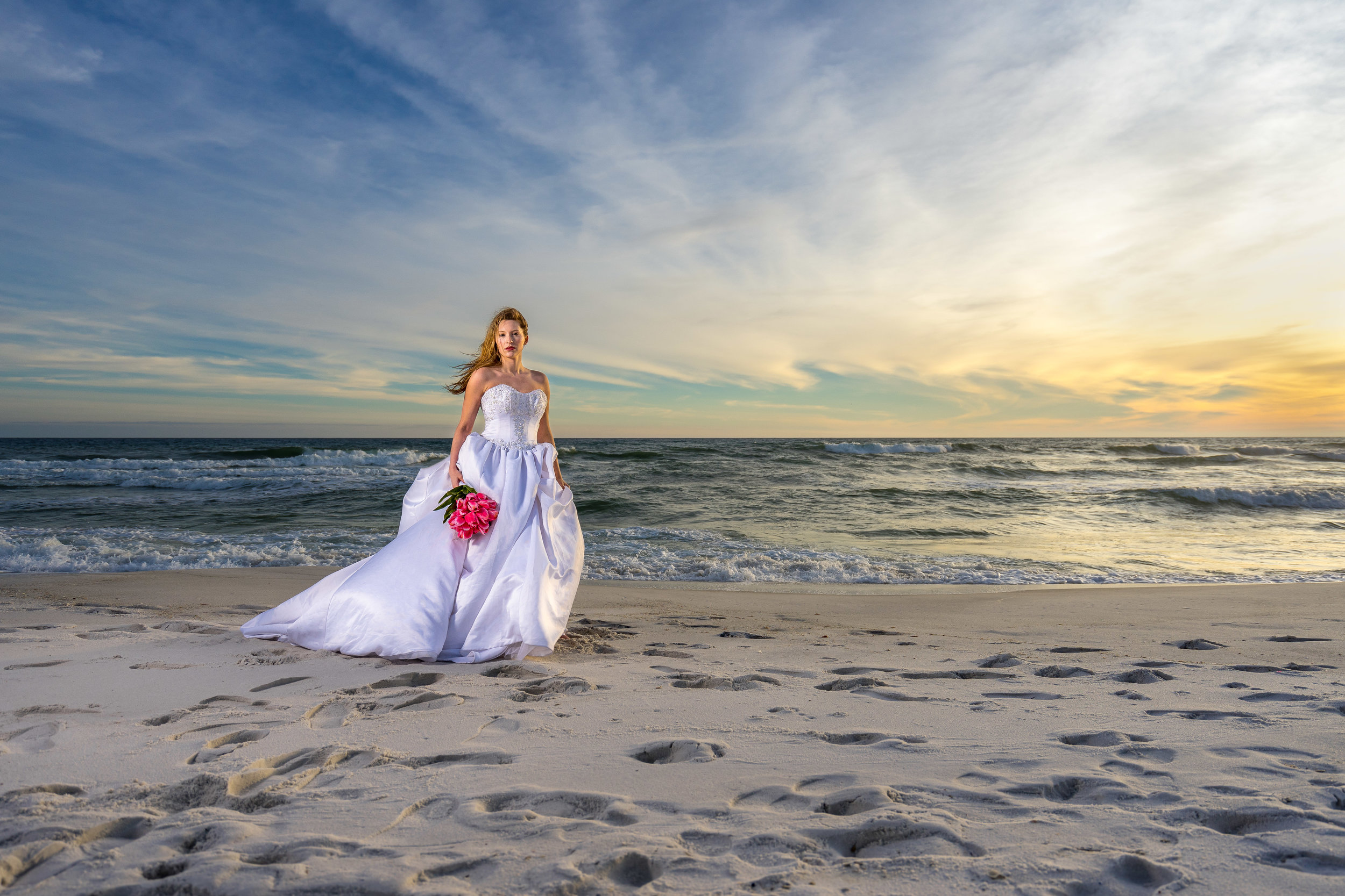image by photographer adam cotton of beautiful beach bridal with wedding dress and bouquet in pensacola florida