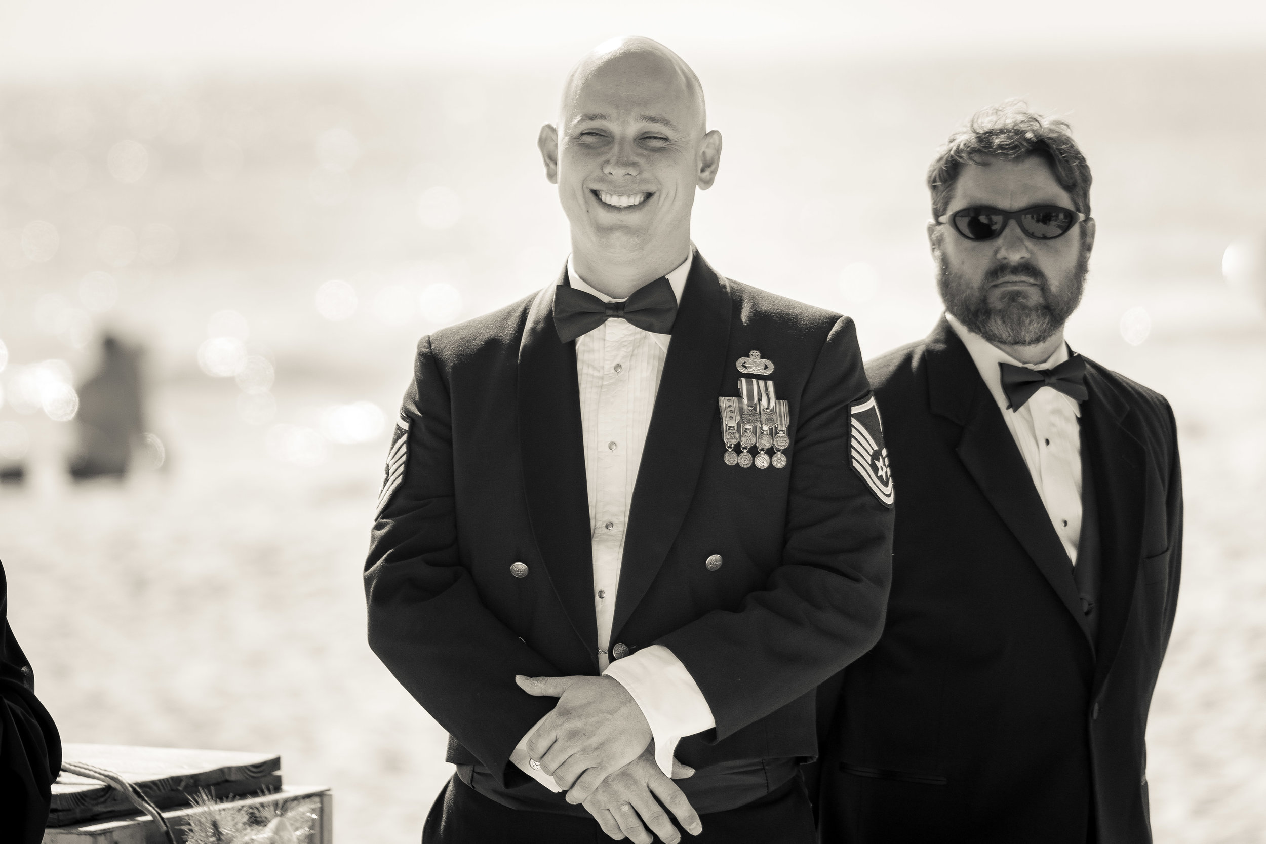image by wedding photographer adam cotton of groom looking at bride during ceremony