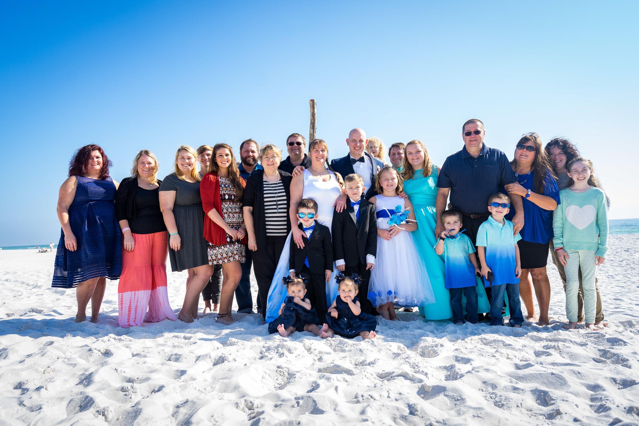 image of family portrait during pensacola beach wedding