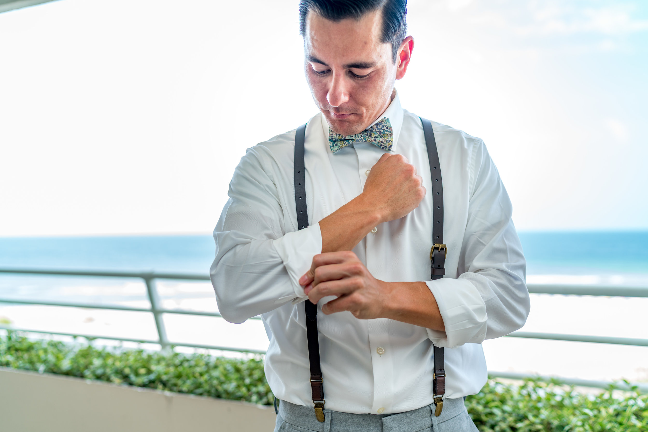 groom-getting-ready-suspenders.jpg