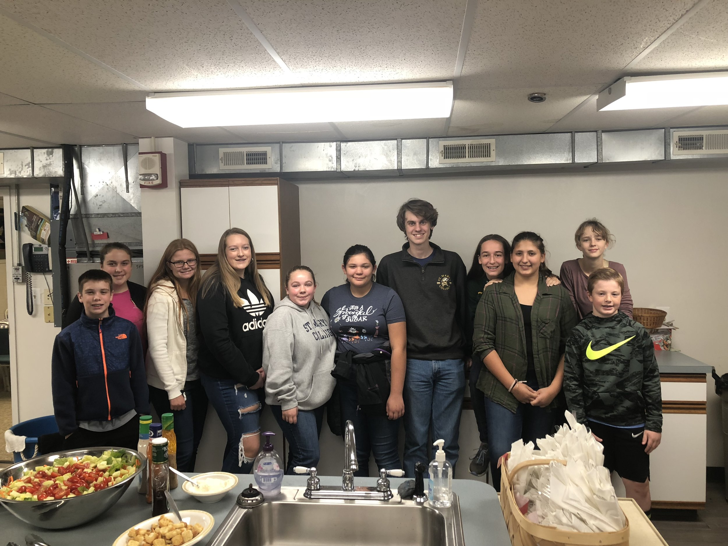 Youth sponsored W.A.R.M. (Wrapping arms 'round many) evening November 11, 2018