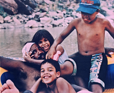Young Arlo - with siblings Emma and Obe and father Jose - falling in love with the river.