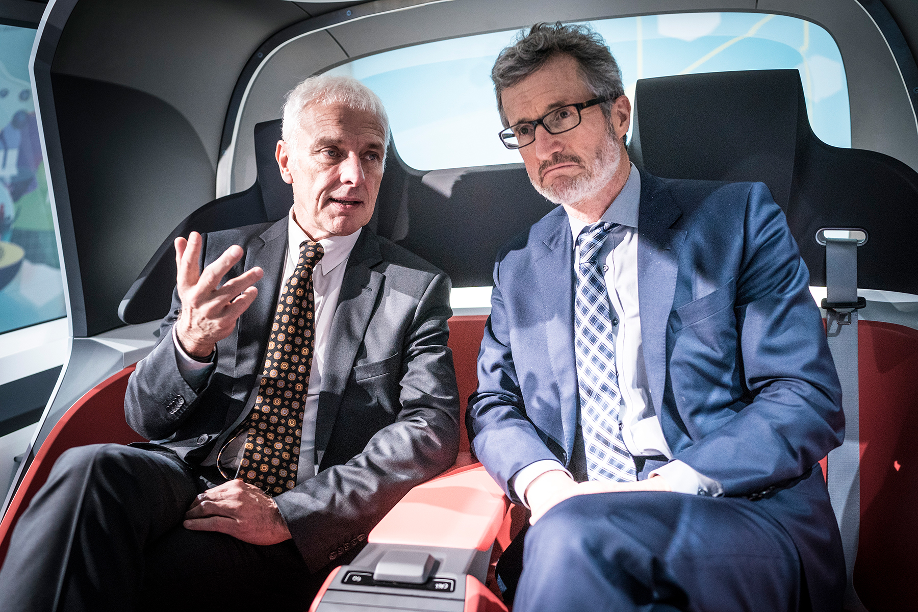 Matthias Müller, left, has a surprising message. Georg Kell, founder of the United Nations Global Compact and a VW adviser, listens. Source: Dominik Butzmann for Handelsblatt
