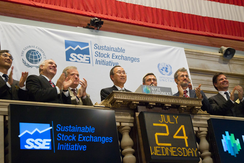 Secretary-General Ban Ki-moon (centre) visited the New York Stock Exchange (NYSE) and rang the bell to mark the close of the day's trading in July 2013. The visit was intended to welcome NYSE Euronext to the UN Sustainable Stock Exchanges (SSE) initiative which explores how exchanges can work together with investors, regulators, and companies to enhance corporate transparency, as well as performance on environmental, social and corporate governance issues. UN Photo/Rick Bajornas
