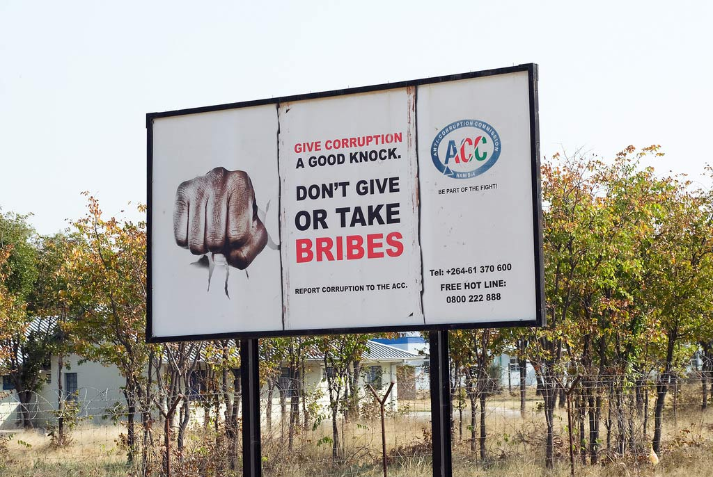 The Global Compact's 10th Principle asserts that businesses should work against corruption in all its forms, including extortion and bribery. Seen here is a billboard in Namibia promoting anti-corruption. Photo: World Bank/Philip Schuler