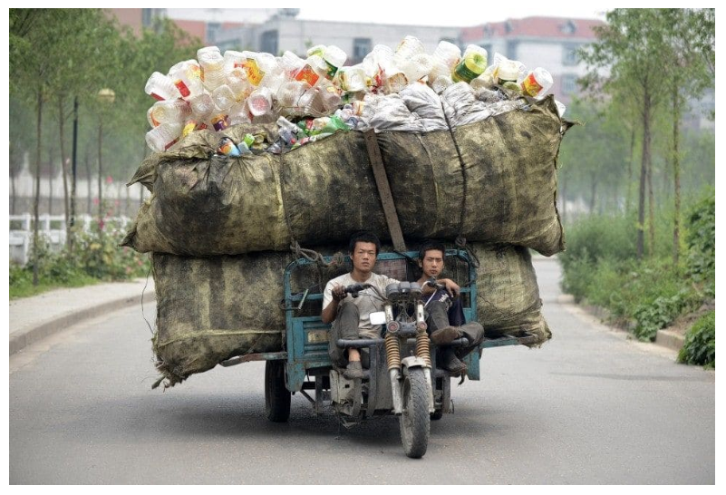 Motorcyclist In China Carrying A Ton Of Plastic Trash.png