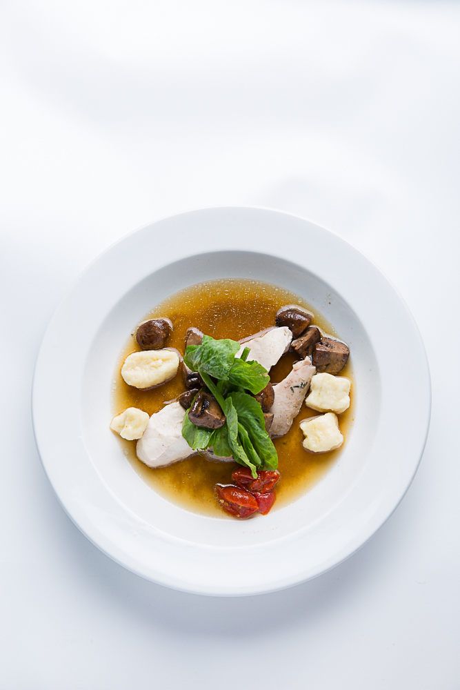 Potato gnocchi, toasted tomato, poached chicken, mushrooms, mushroom broth