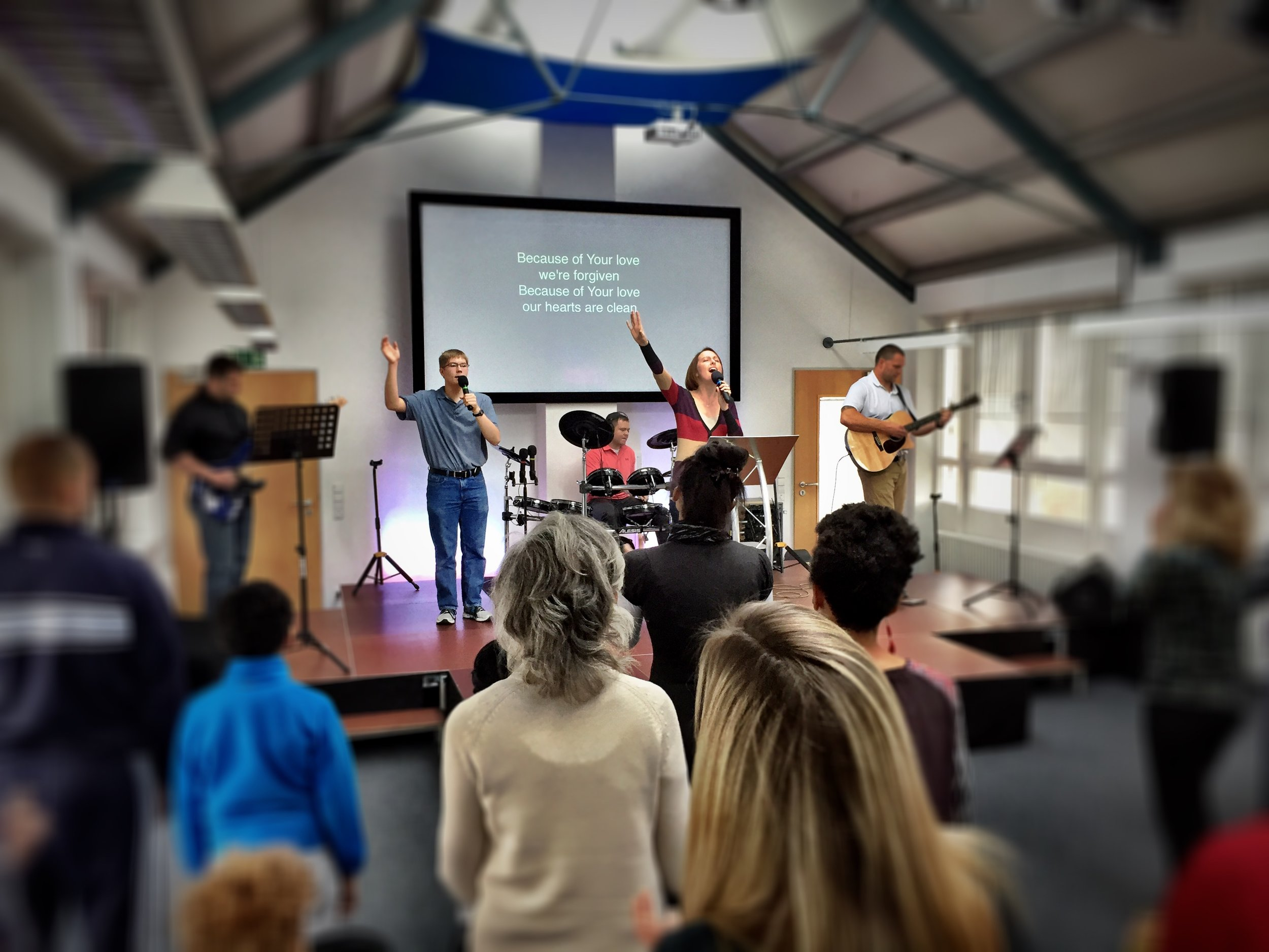 Stacey and the worship team leading the song service in the new building.