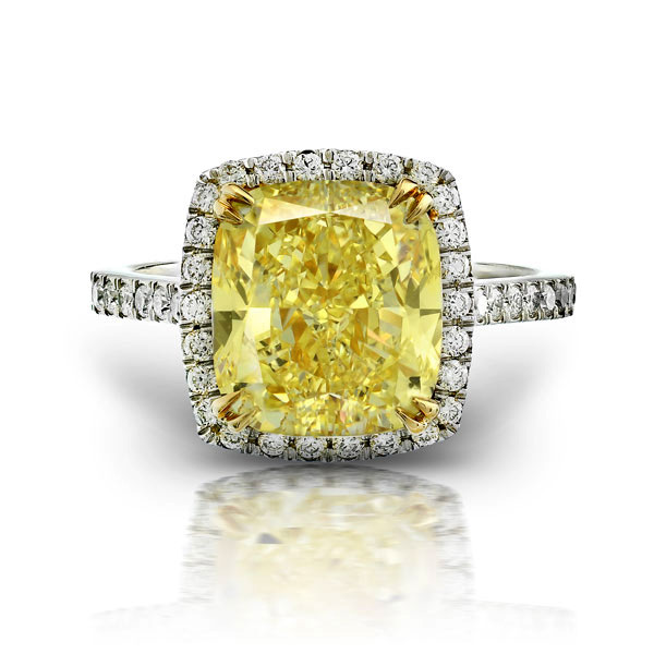 FANCY YELLOW CUSHION CUT DIAMOND WITH COLORLESS ROUND DIAMONDS CRAFTED IN 18K YELLOW GOLD AND PLATINUM, 5.57 CTW