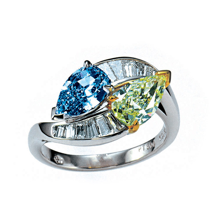 FANCY VIVID BLUE AND FANCY INTENSE GREEN PEAR SHAPE DIAMONDS WITH COLORLESS BAGUETTE DIAMONDS CRAFTED IN PLATINUM AND 18K YELLOW GOLD, 2.50 CTW